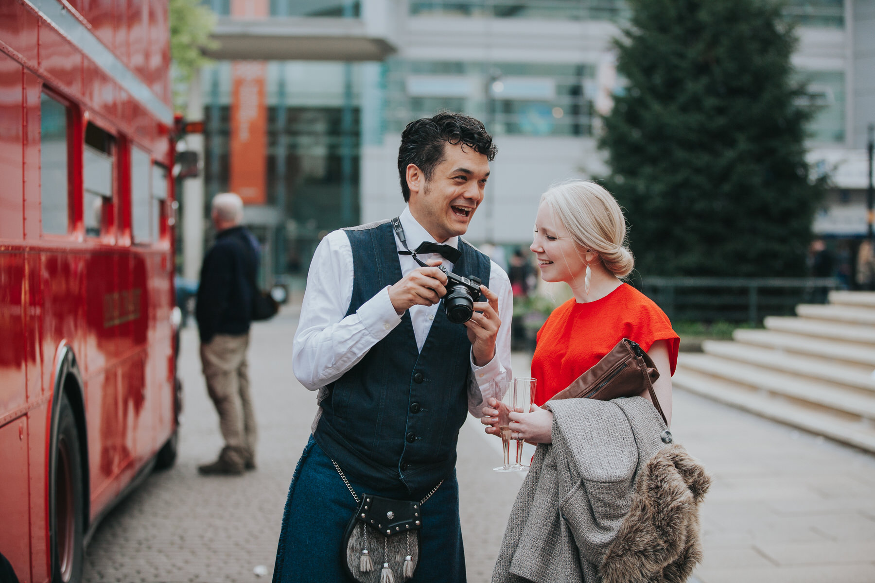 MS-Londesborough-Pub-wedding-Hackney-alternative-photographer-139-guests-drinking-bubbly-red-london-wedding-bus.jpg