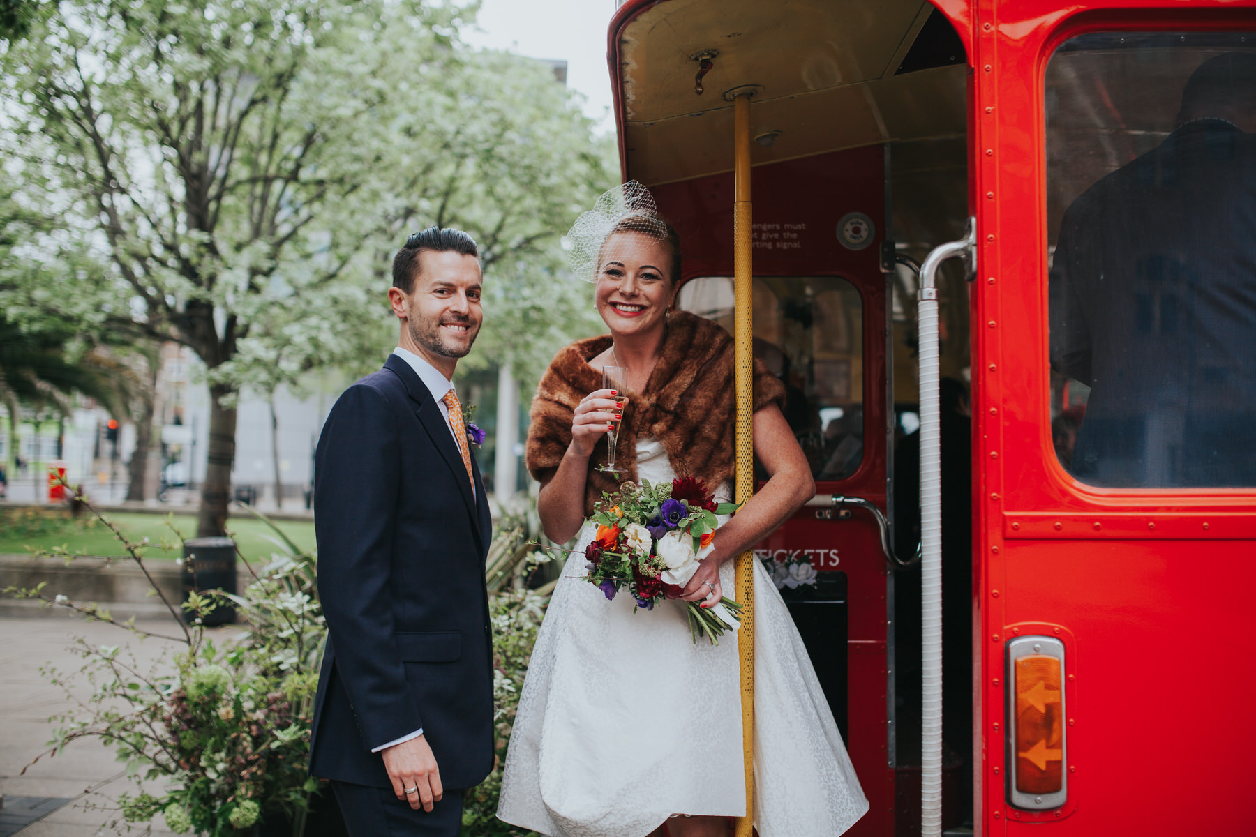 MS-Londesborough-Pub-wedding-Hackney-alternative-photographer-144-newly-married-bride-groom-drinking-bubbly-red-london-wedding-bus.jpg