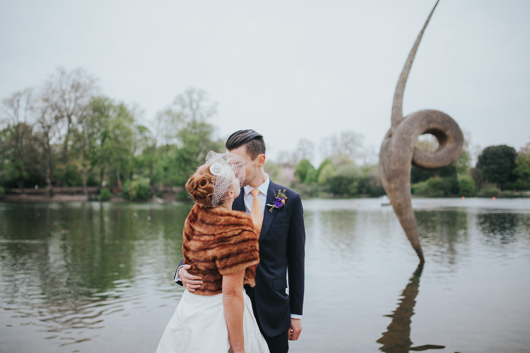 MS-Londesborough-Pub-wedding-Hackney-alternative-photographer-155-just-married-quirky-bride-groom-kissing-lake-Victoria-Park.jpg
