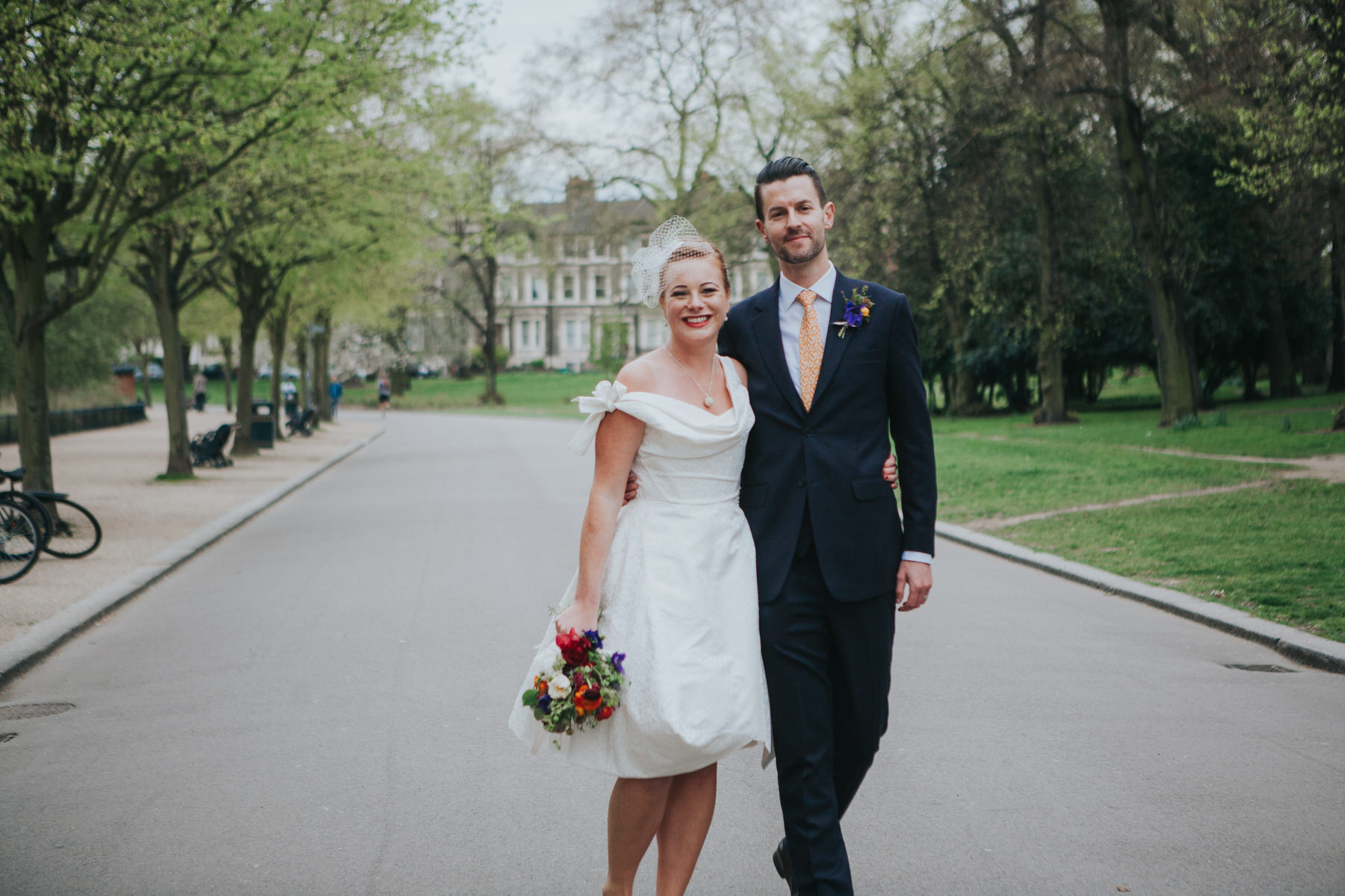 174-Hackney-alternative-wedding-couple-walking-park.jpg