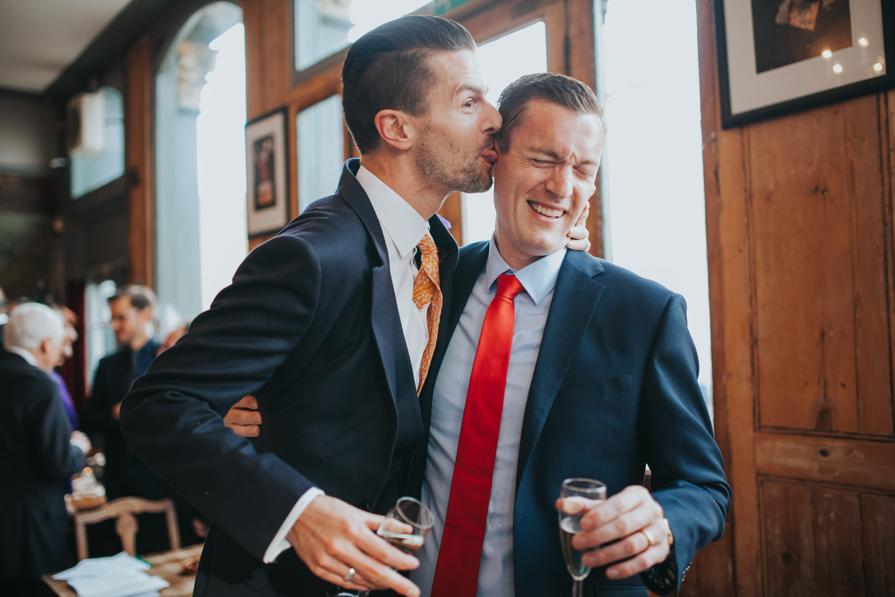 groom licking friends face reportage wedding photo