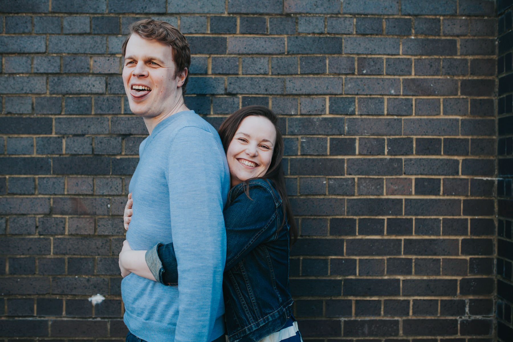 57-Quirky-engagement-London-brick-wall-squeeze.jpg