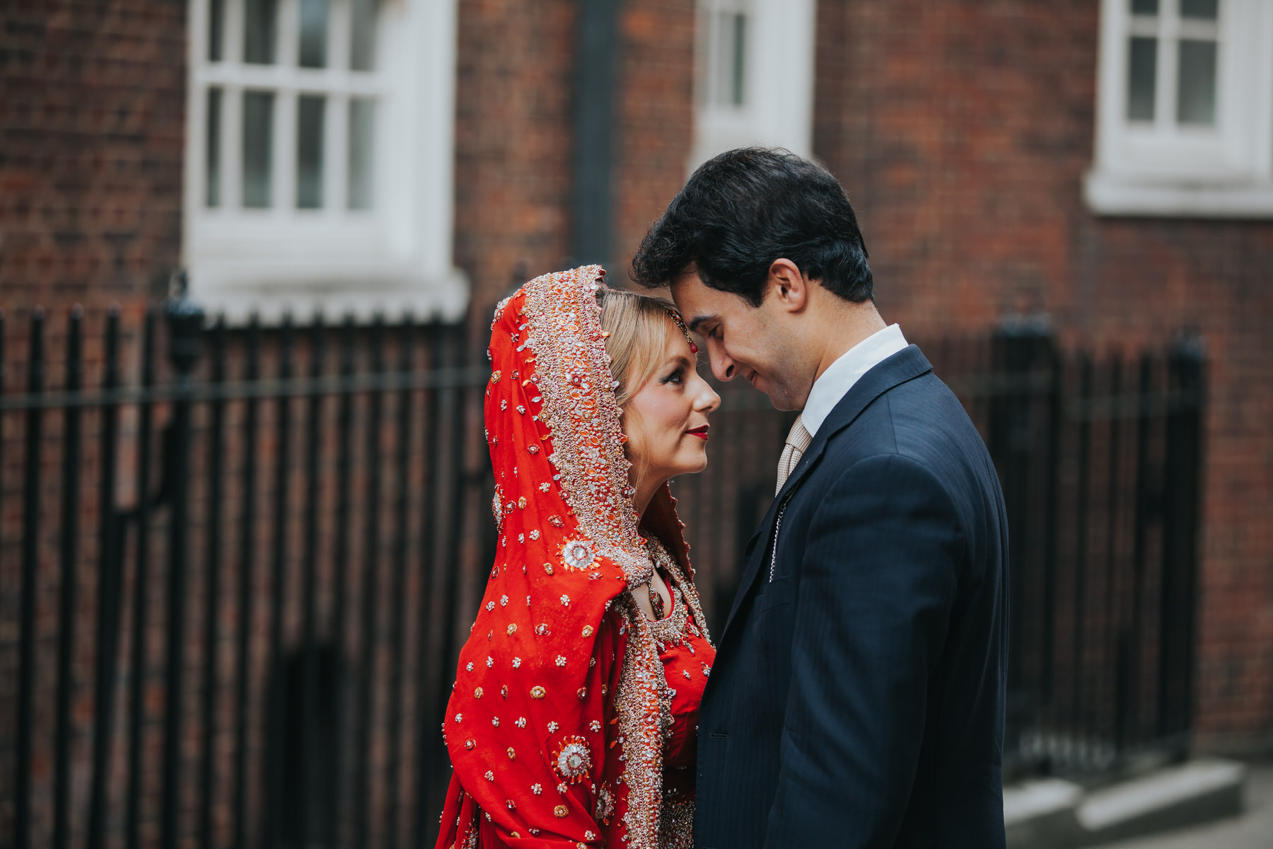 5-Anglo-Asian-London-Wedding-Middle-temple-bride-wearing-red-sari.jpg