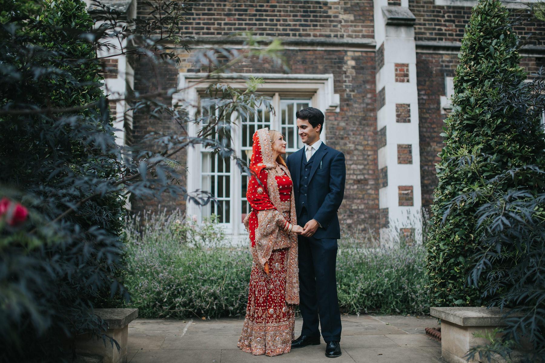 22-Anglo-Asian-London-Wedding-Middle-temple-bride-groom-posing-garden.jpg