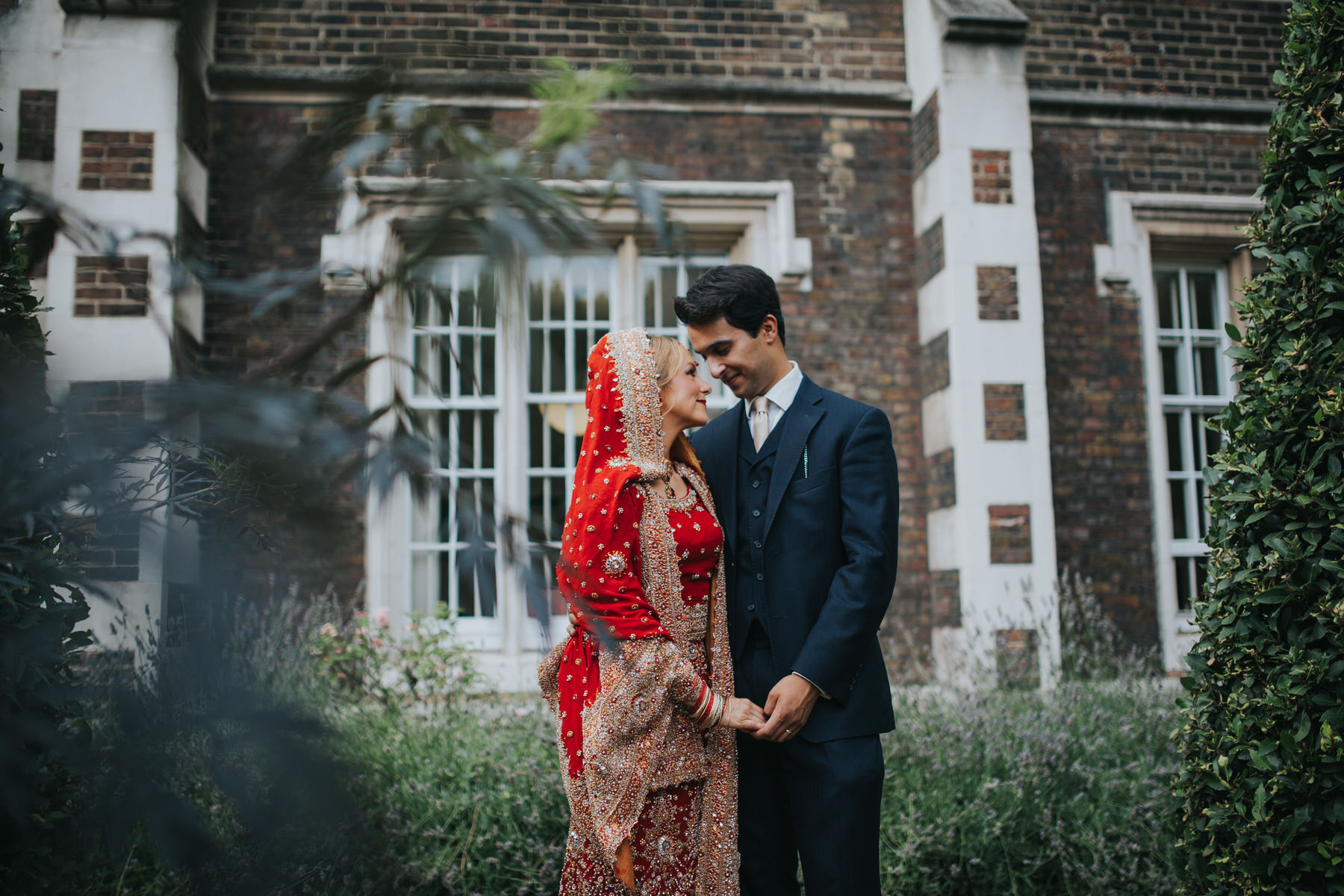 24-Anglo-Asian-London-Wedding-Middle-temple-bride-groom-holding-hands.jpg