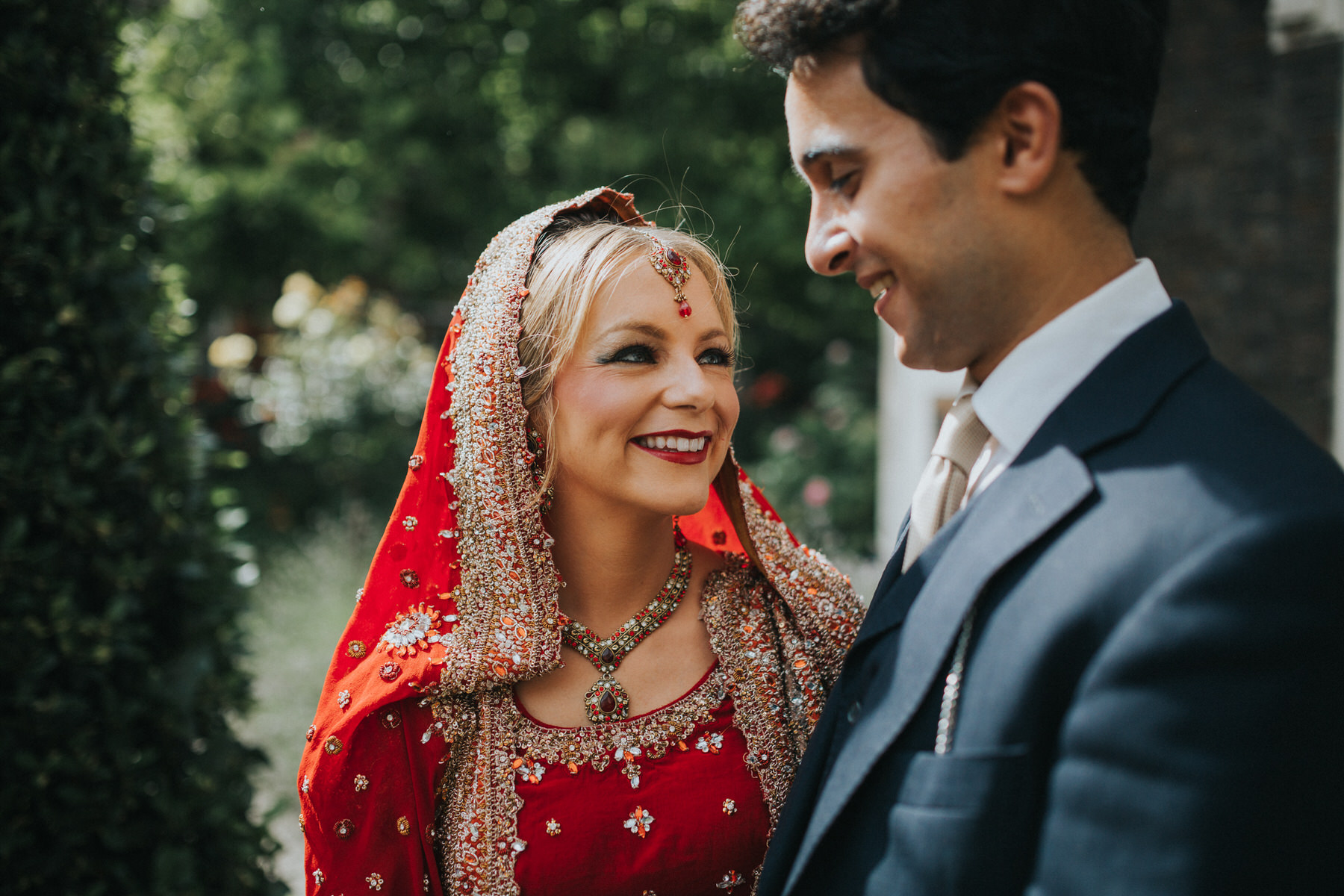 28-Anglo-Asian-London-Wedding-Middle-temple-groom-looking-bride.jpg