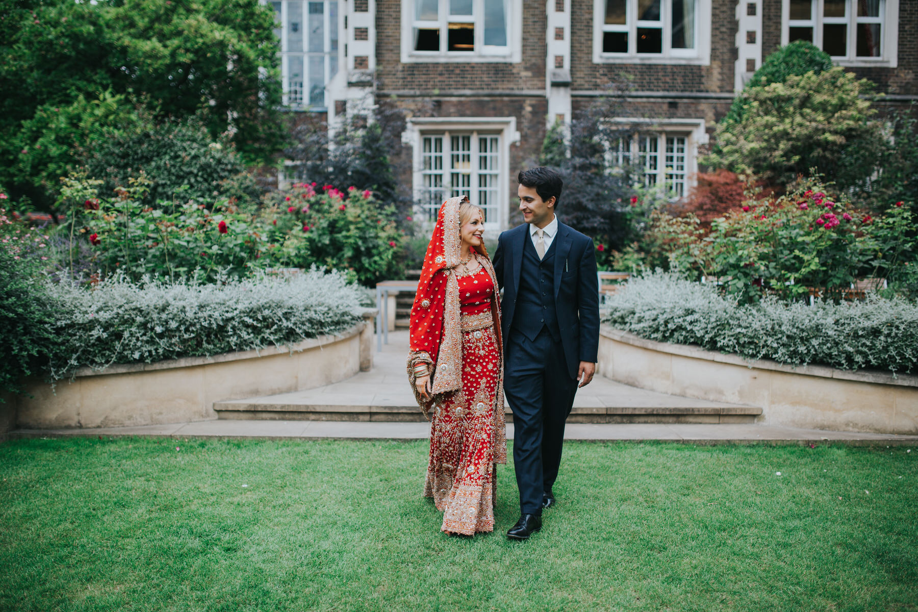 44-Anglo-Asian-London-Wedding-Middle-temple-bride-groom-walking-garden.jpg