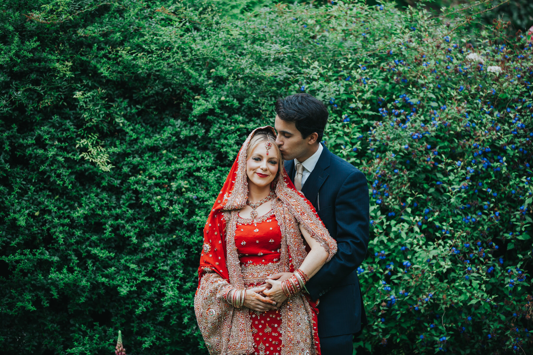 49-Anglo-Asian-London-Wedding-Middle-temple-groom-bride-red-sari-blue-flowers.jpg