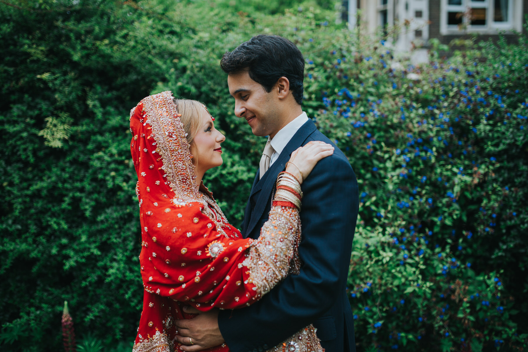 54-Anglo-Asian-London-Wedding-Middle-temple-bride-groom-embracing.jpg