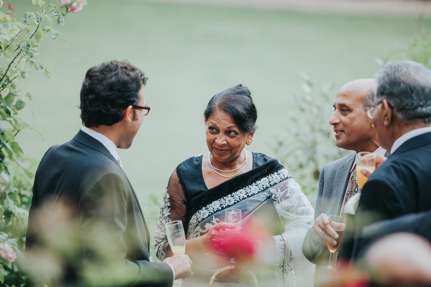 108-Anglo-Asian-London-Wedding-drinks-reception-guests-champagne-cocktails.jpg