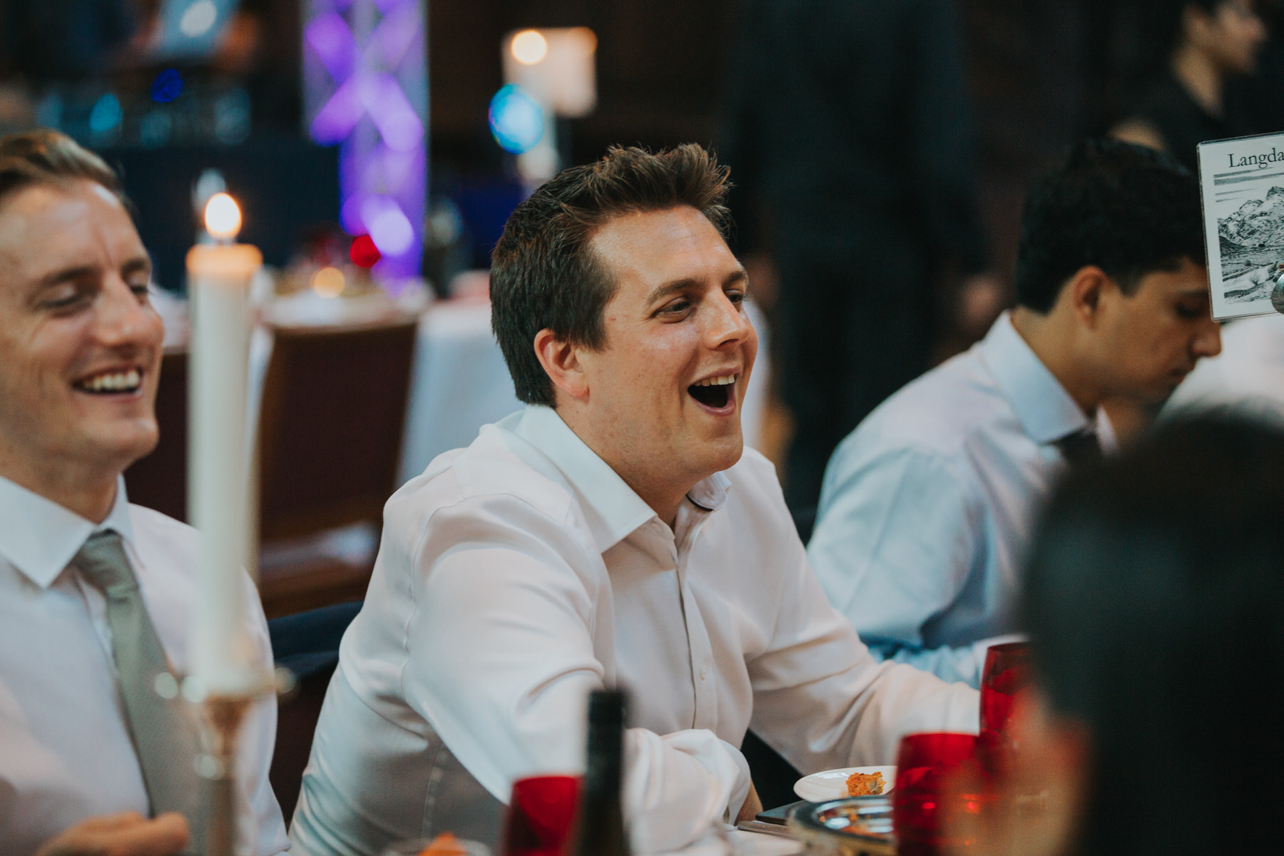 190-Anglo-Asian-London-Wedding-Middle-temple-guests-laughing.jpg