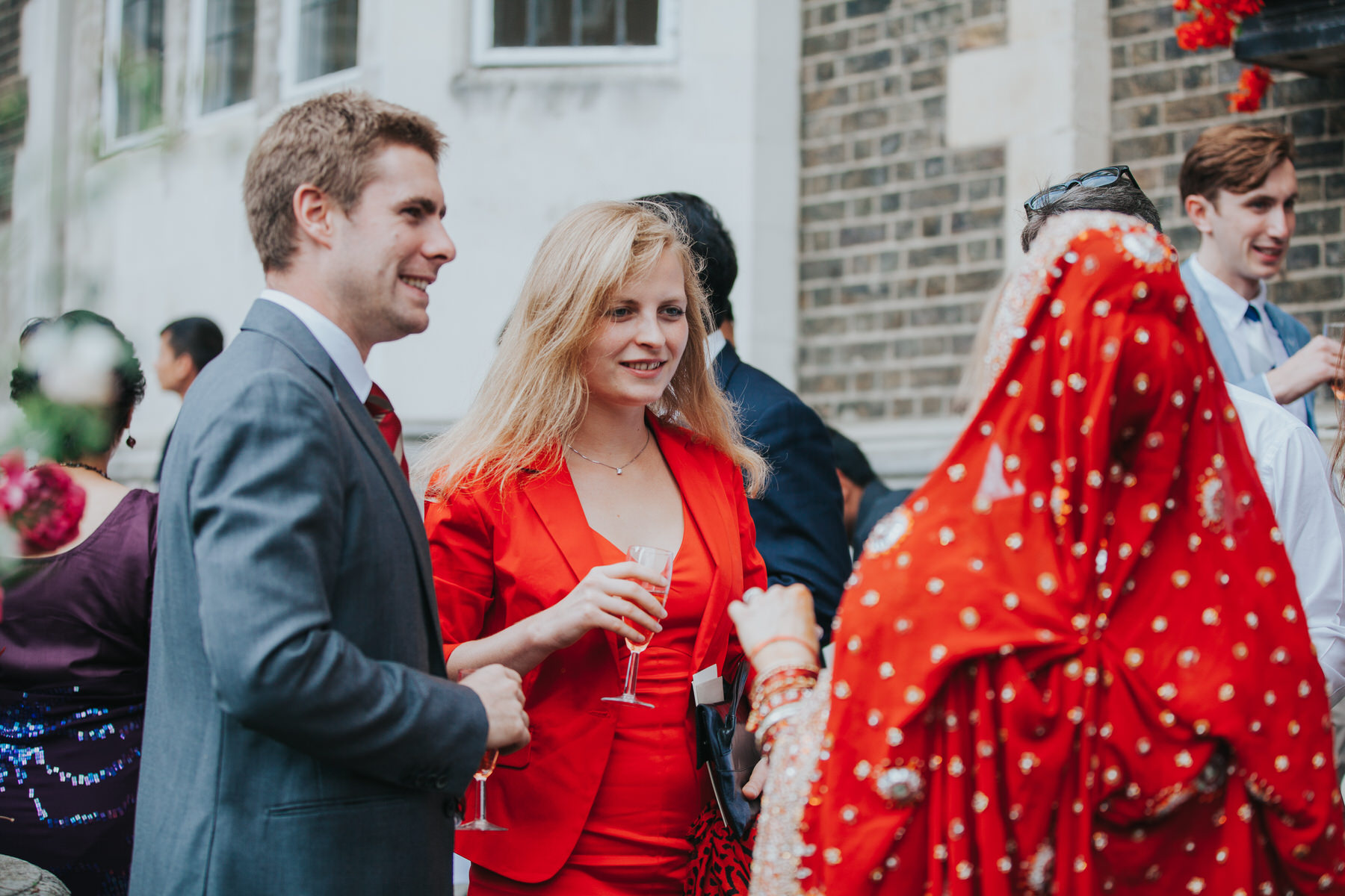 123-Anglo-Asian-Wedding-Middle-temple-guests-talking-bride.jpg