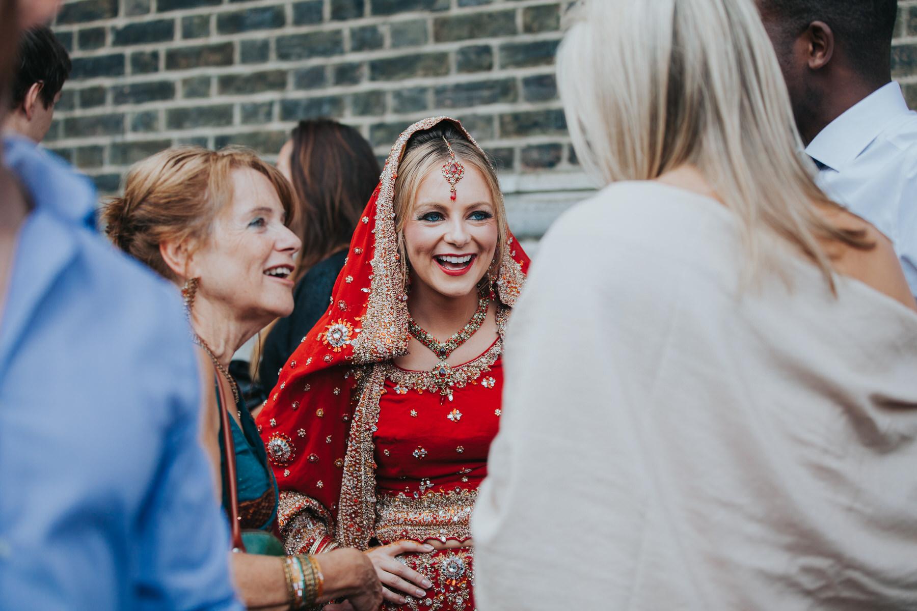 138-Anglo-Asian-London-Wedding-bride-mum-laughing.jpg