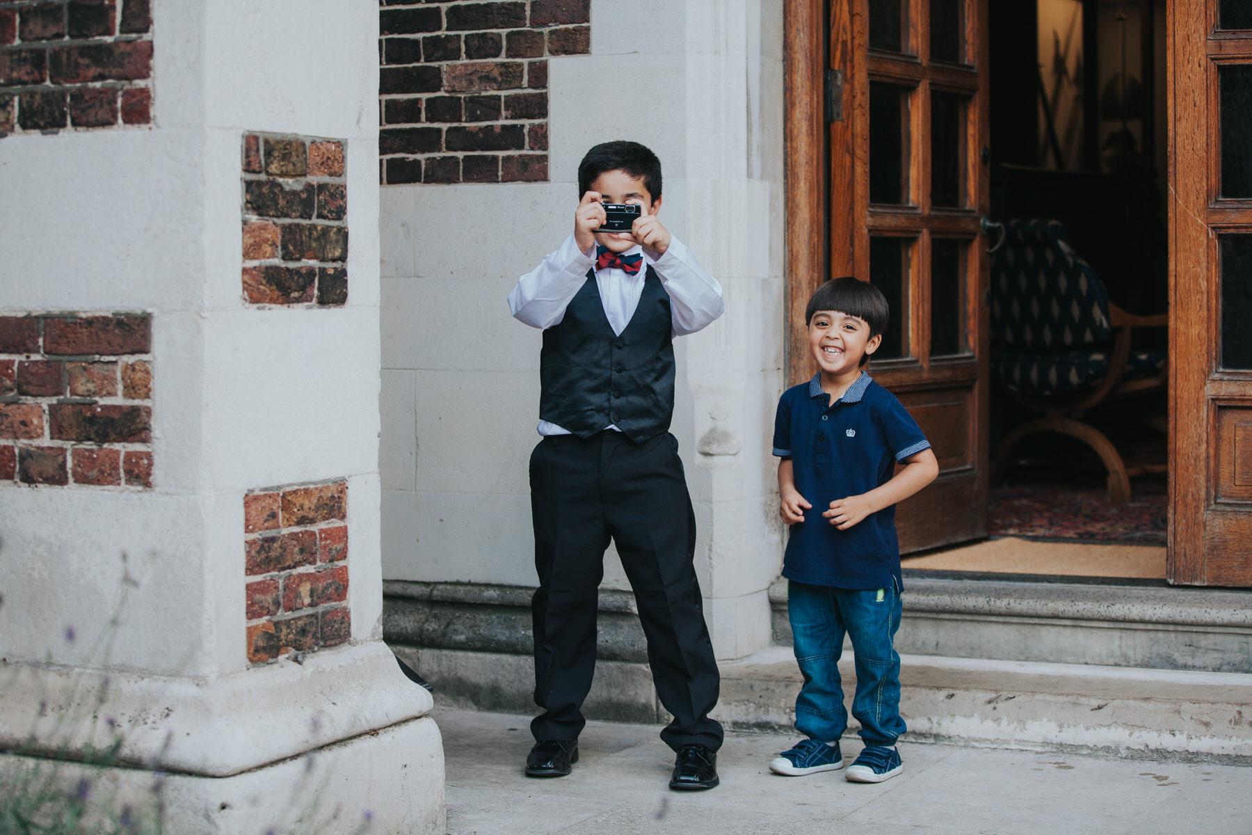 144-Anglo-Asian-London-Wedding-kids-with-camera.jpg