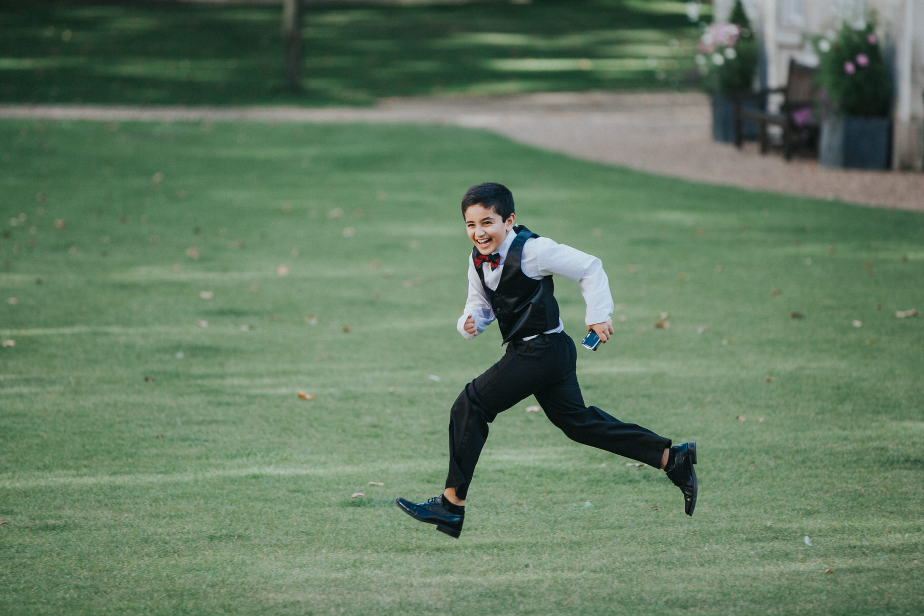 150-Anglo-Asian-Wedding-boy-guest-action-shot.jpg