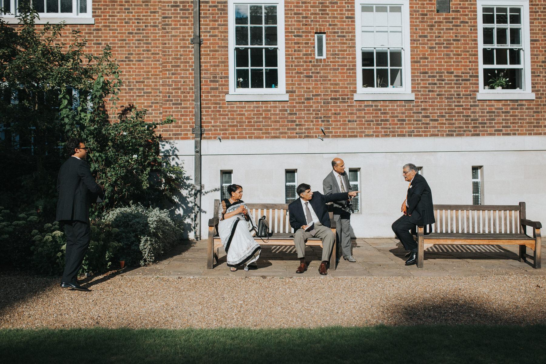 149-Anglo-Asian-London-Wedding-guests-relaxing-garden.jpg