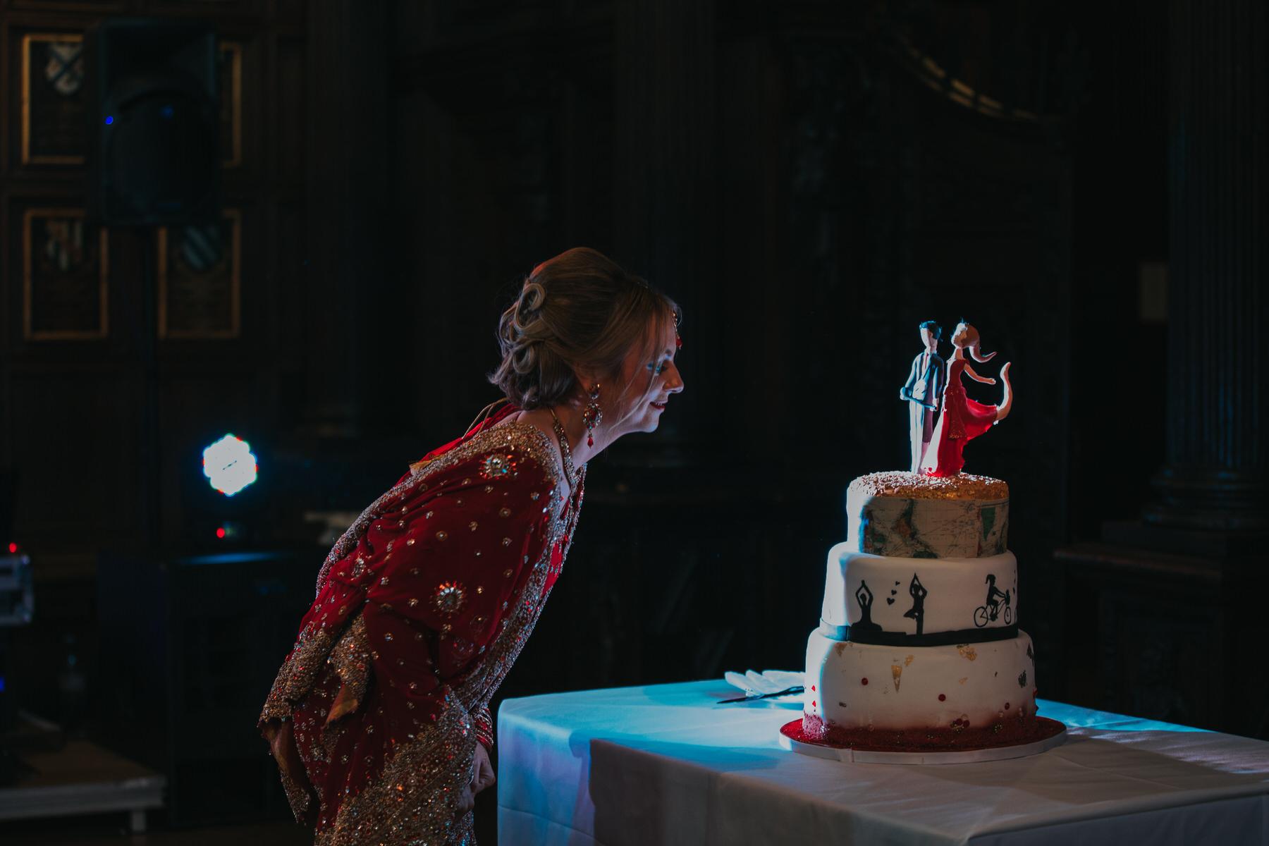 191-bride-looking-unique-wedding-cake-dark.jpg