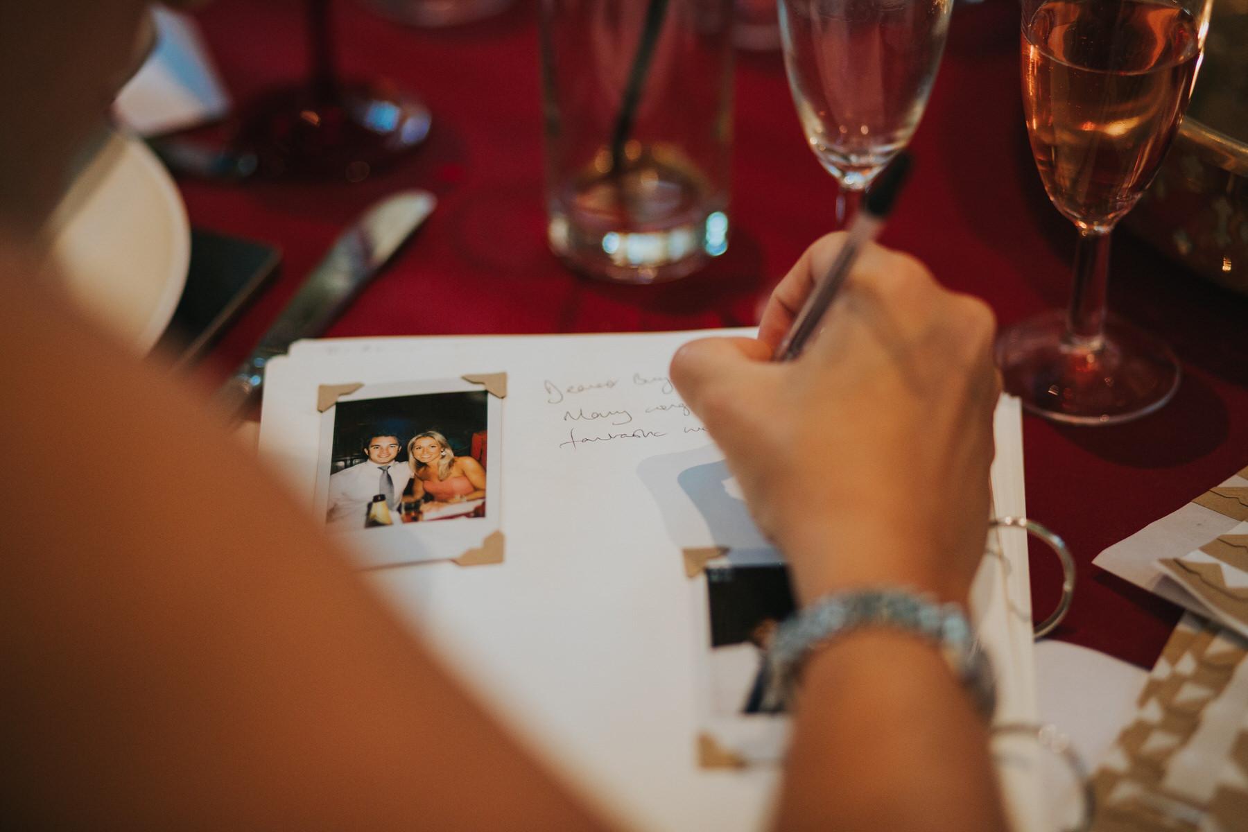 218-guests-writing-wedding-book.jpg