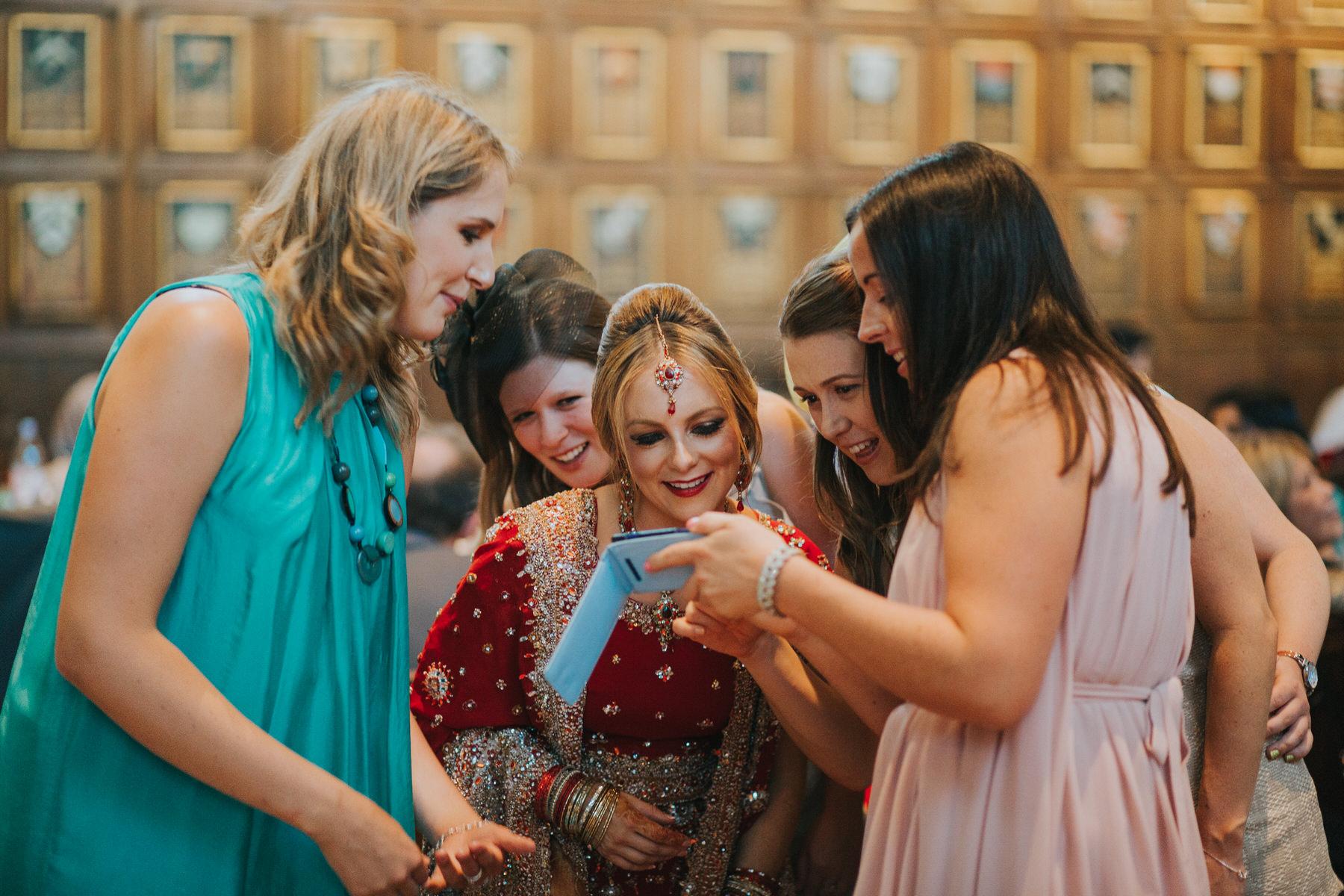 221-bride-red-sari-with-girlfriends.jpg