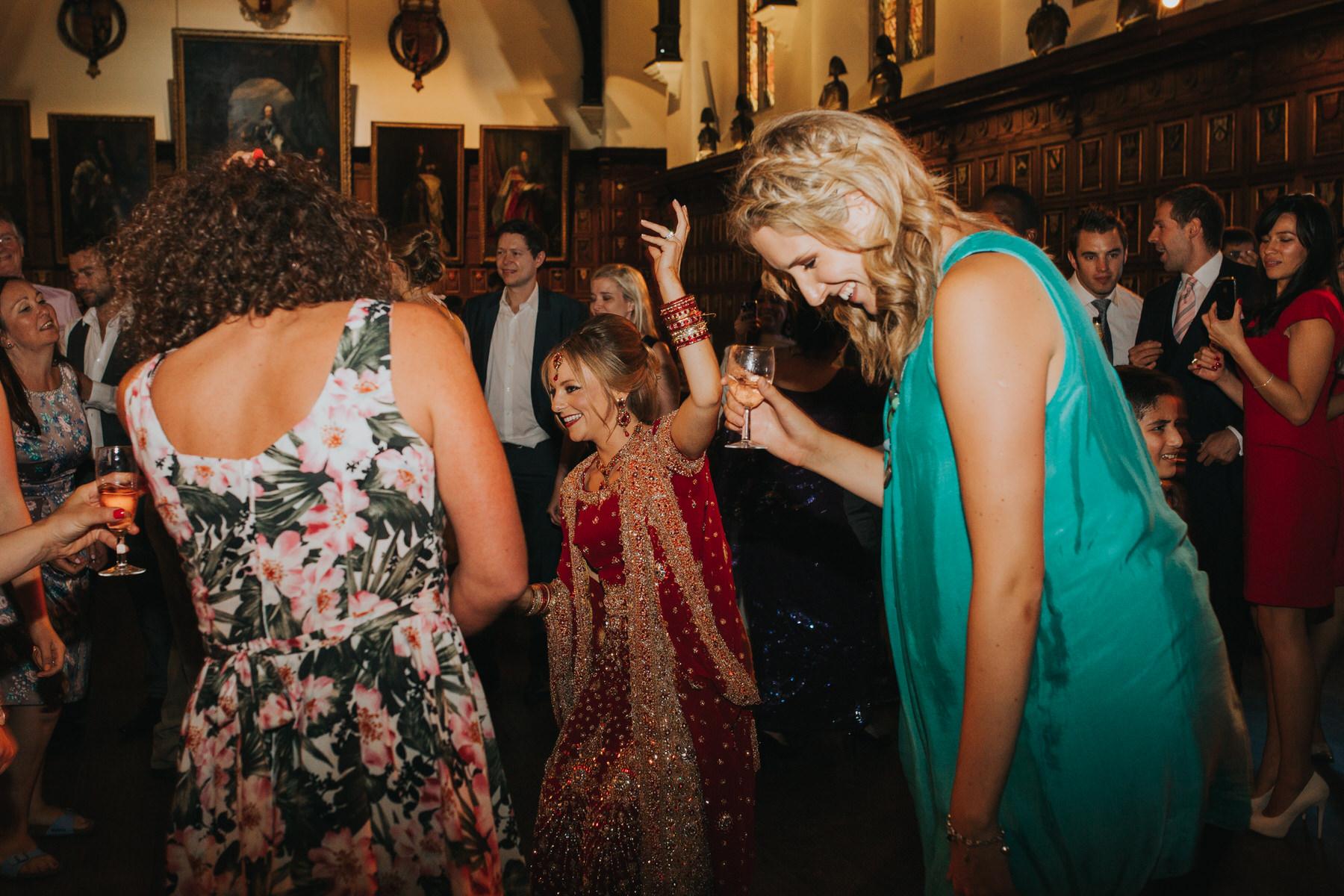 233-Anglo-Asian-wedding-bride-dancing-red-sari.jpg