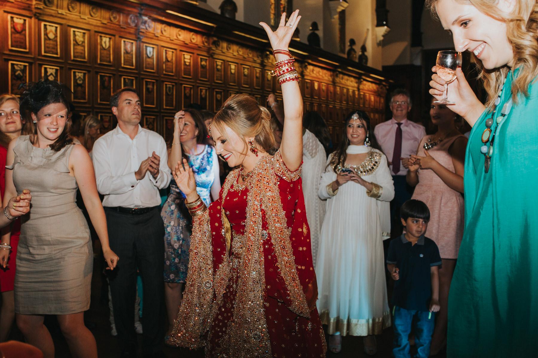 238-Anglo-Asian-London-Wedding-bride-dancing-red-sari.jpg