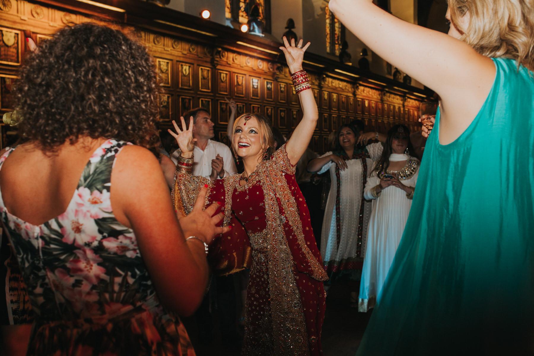 237-Anglo-Asian-wedding-bride-dancing-red-sari.jpg