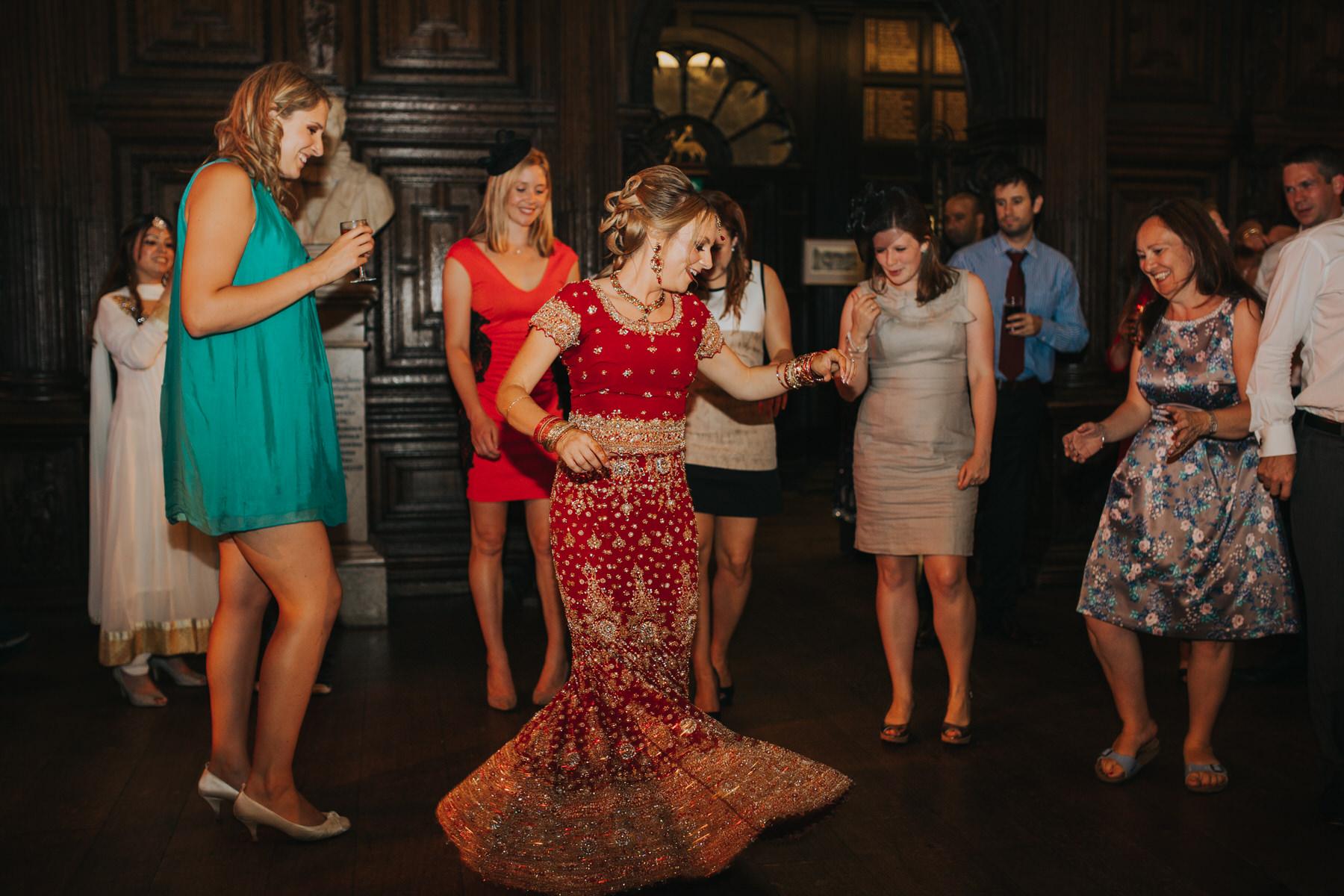 243-Anglo-Asian-London-Wedding-bride-dancing-red-sari.jpg