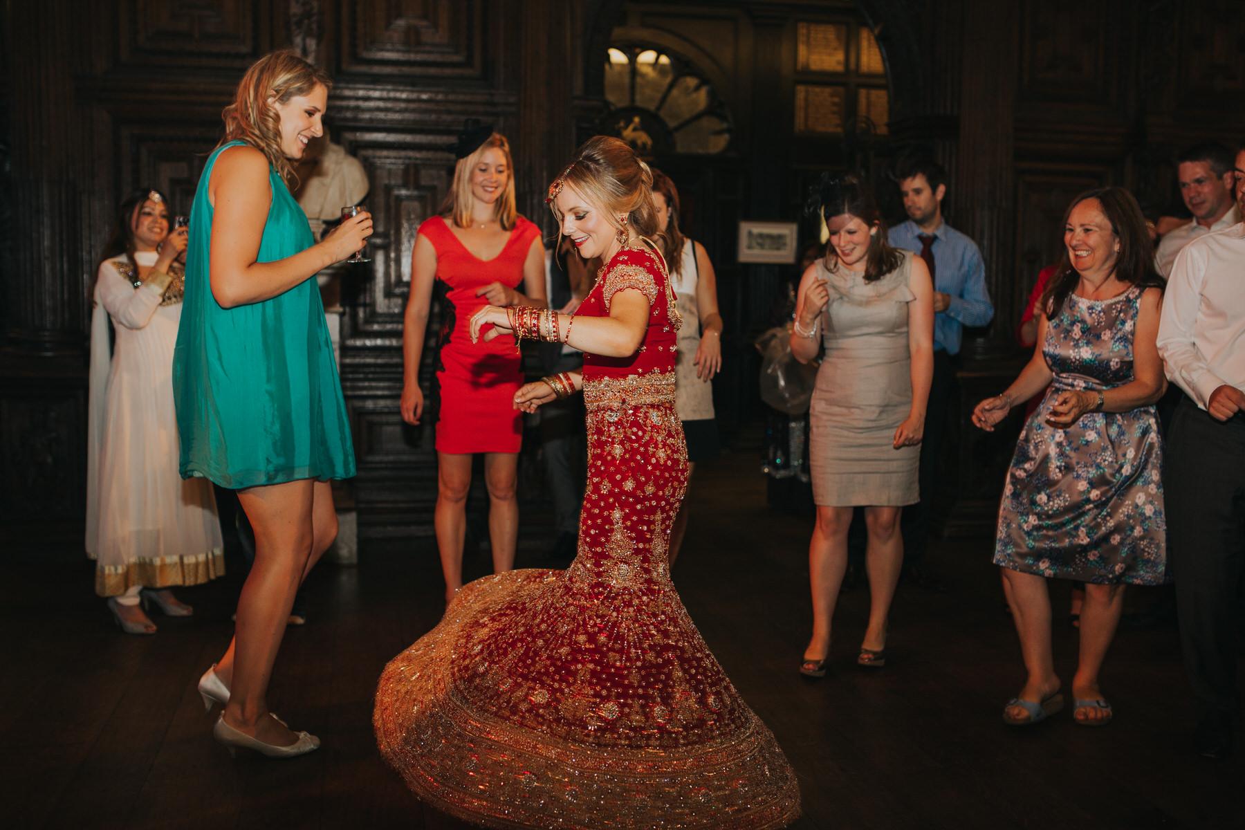 244-Anglo-Asian-London-Wedding-bride-dancing-red-sari.jpg
