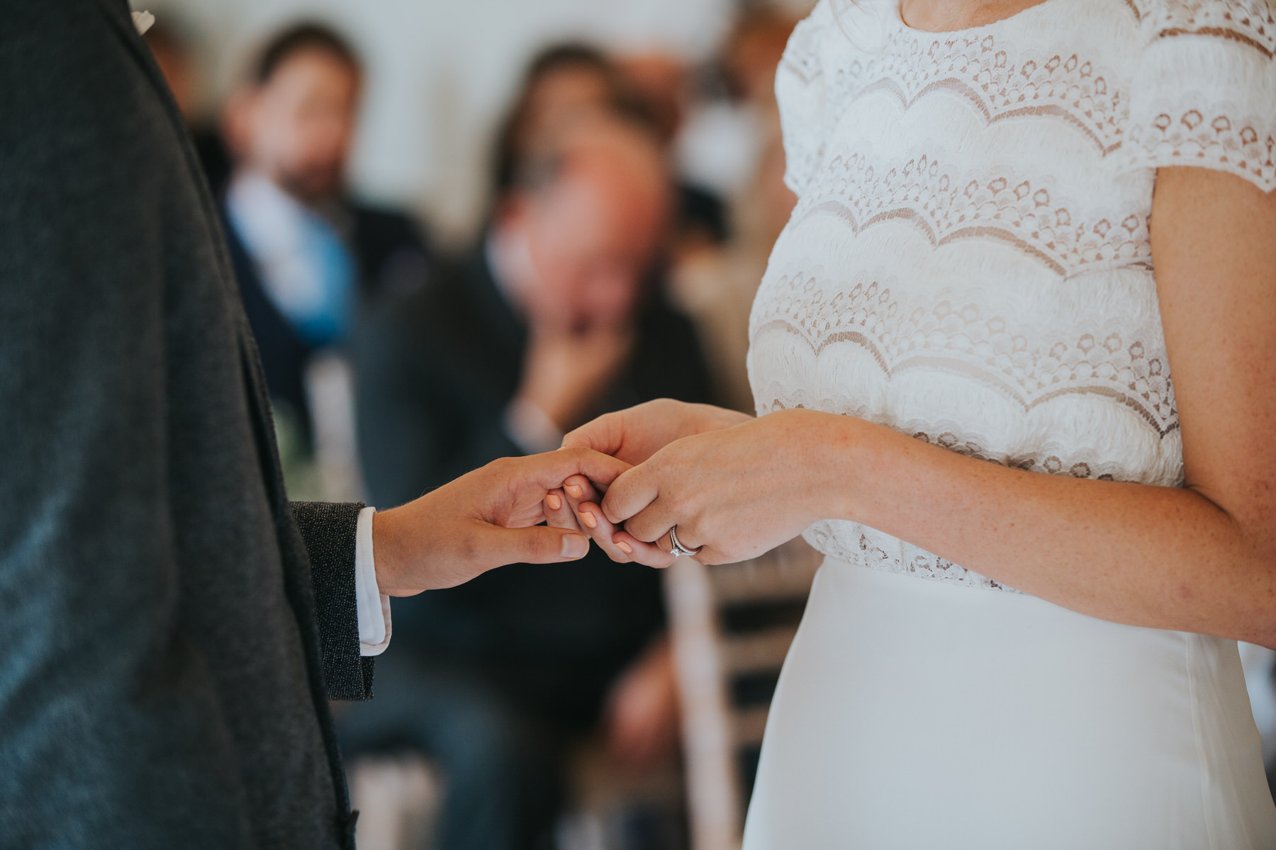 bride exchanging rings with groom Asia House wedding ceremony.jpg