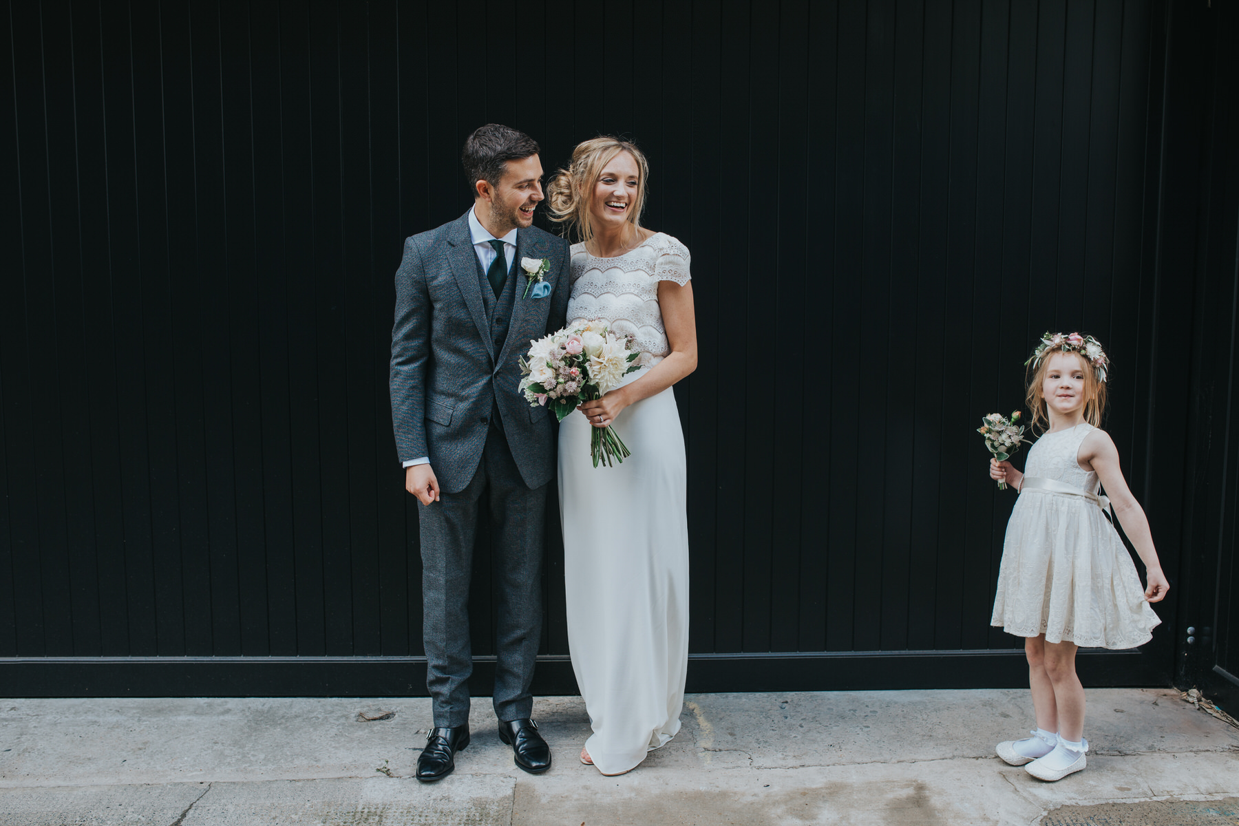 flower girl photobombs newlyweds bridal portrait.jpg