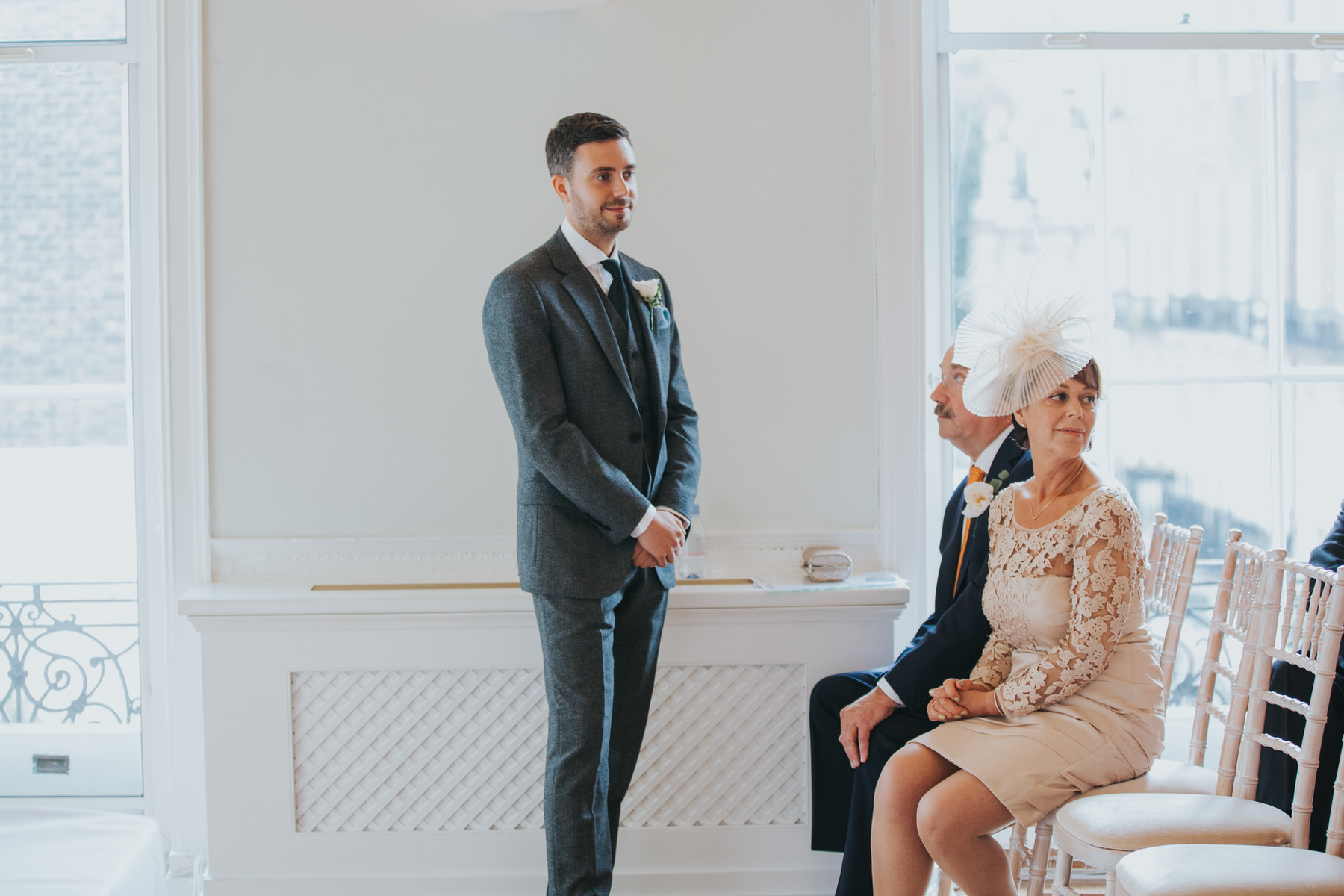 groom waiting with parents Asia House.jpg