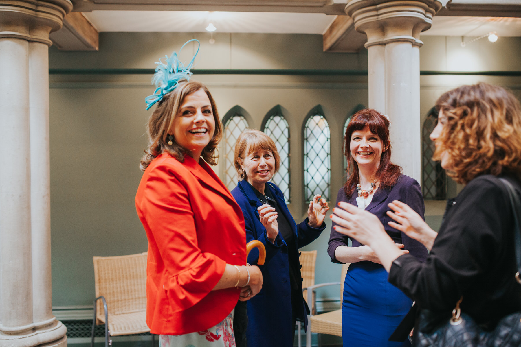 5 female guests waiting Fulham Catholic Church wedding.jpg