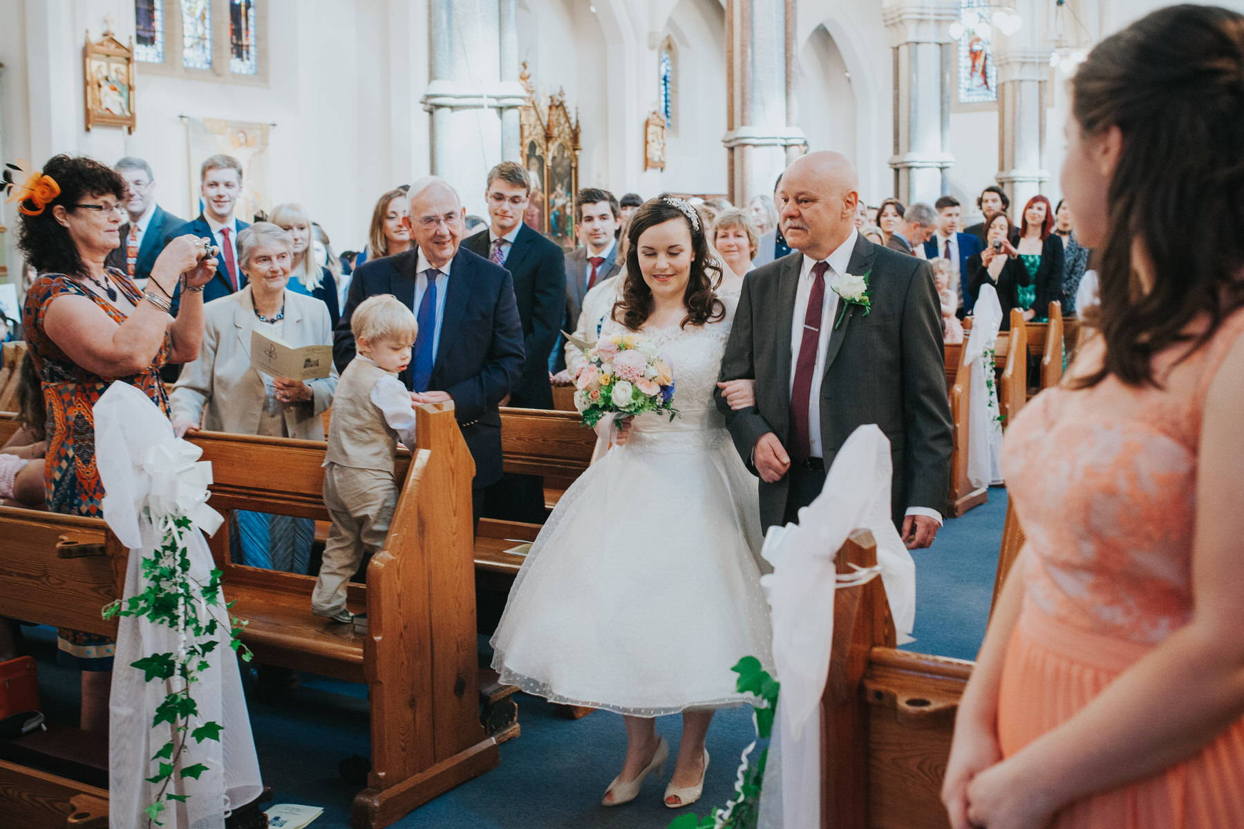 25 bride and dad Fulham Catholic Church wedding.jpg