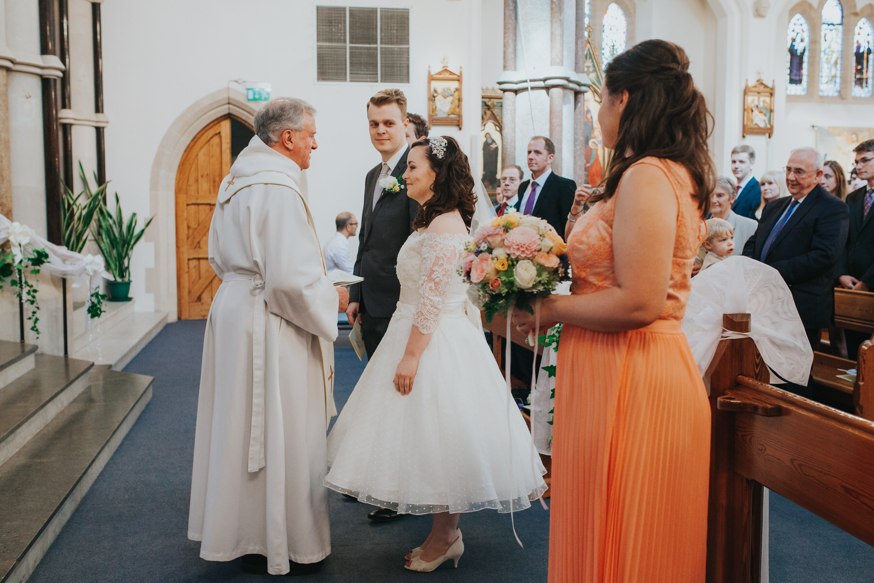27 bride meets priest Catholic wedding.jpg