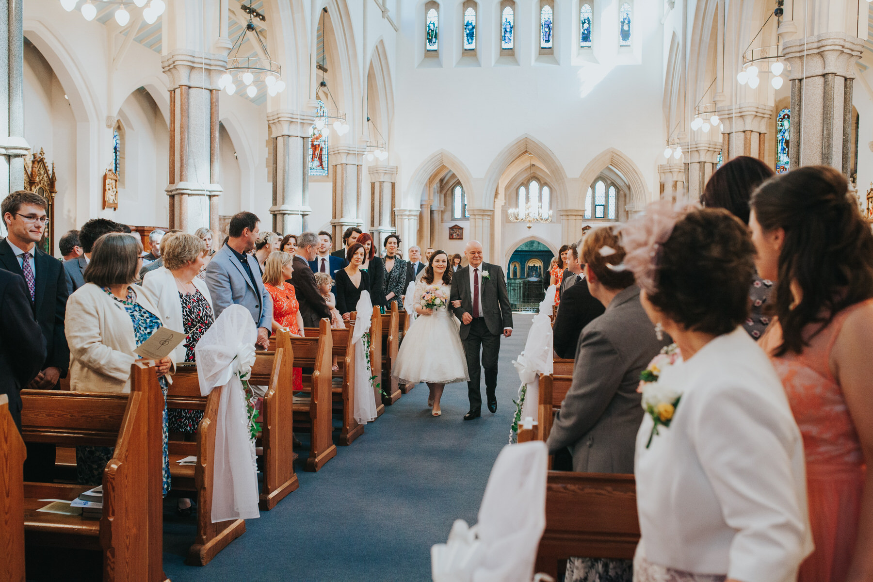 24 bride walking down aisle with dad Catholic Church.jpg