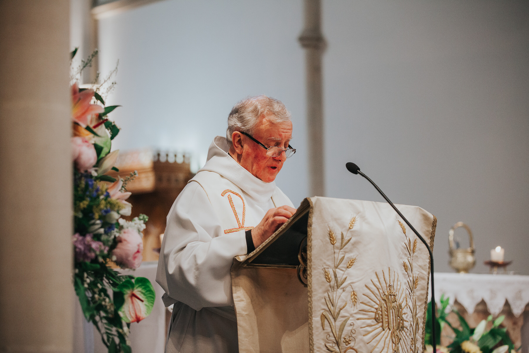 41 Father delivering sermon Fulham Catholic Church wedding.jpg