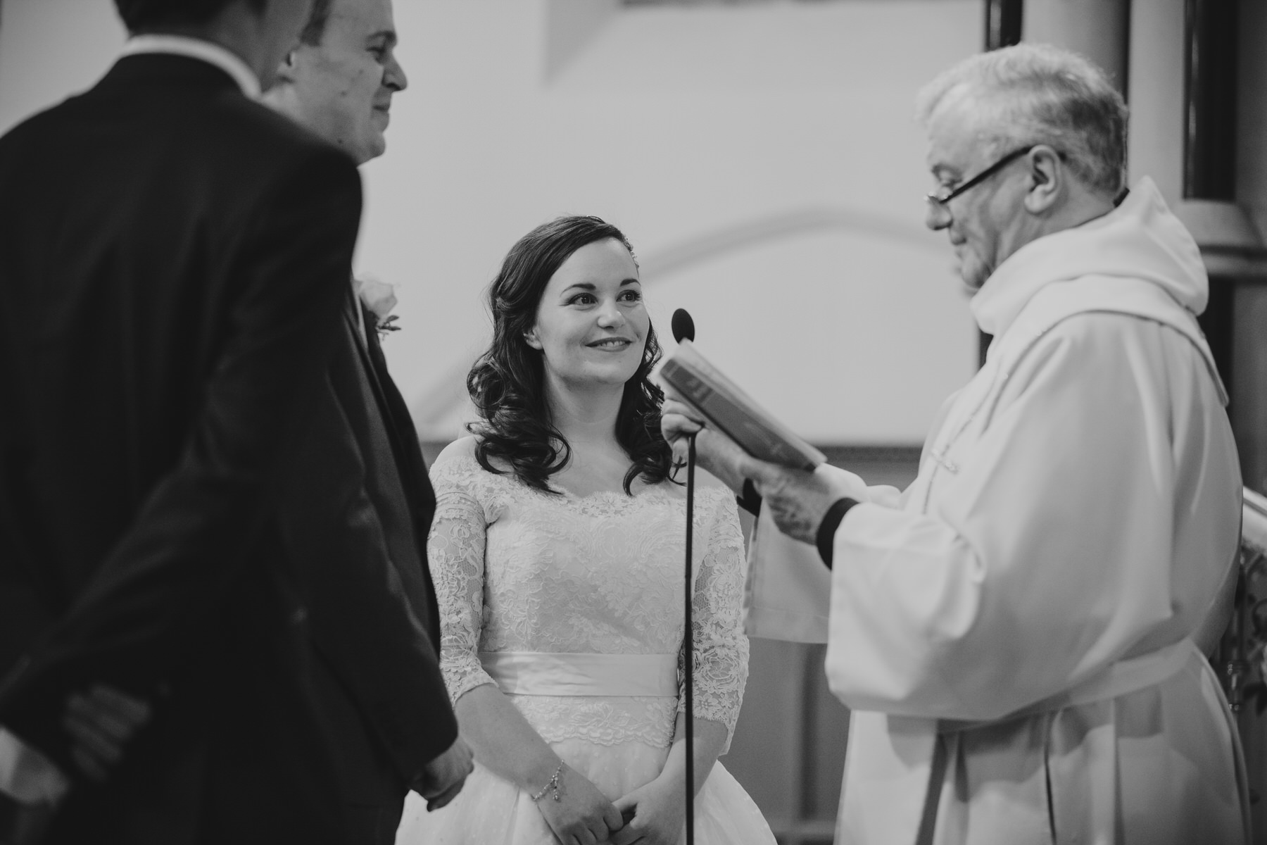 46 Fulham Catholic Church wedding ceremony bride priest.jpg