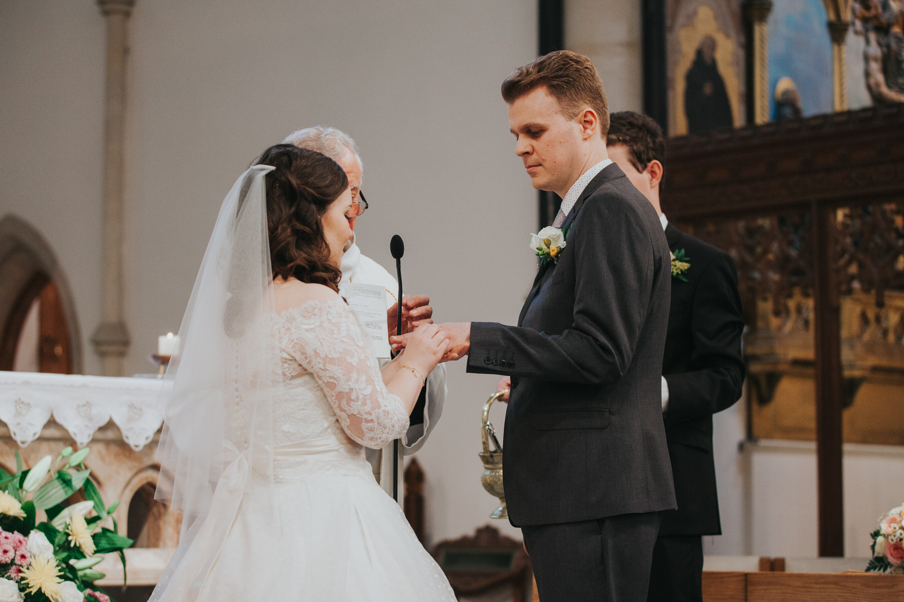 54 exchange of rings during Catholic Church wedding.jpg