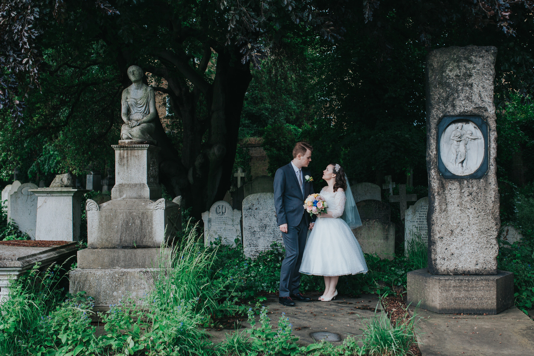 95 groom bride wedding portraits inbetween old graves Brompton Cemetery.jpg