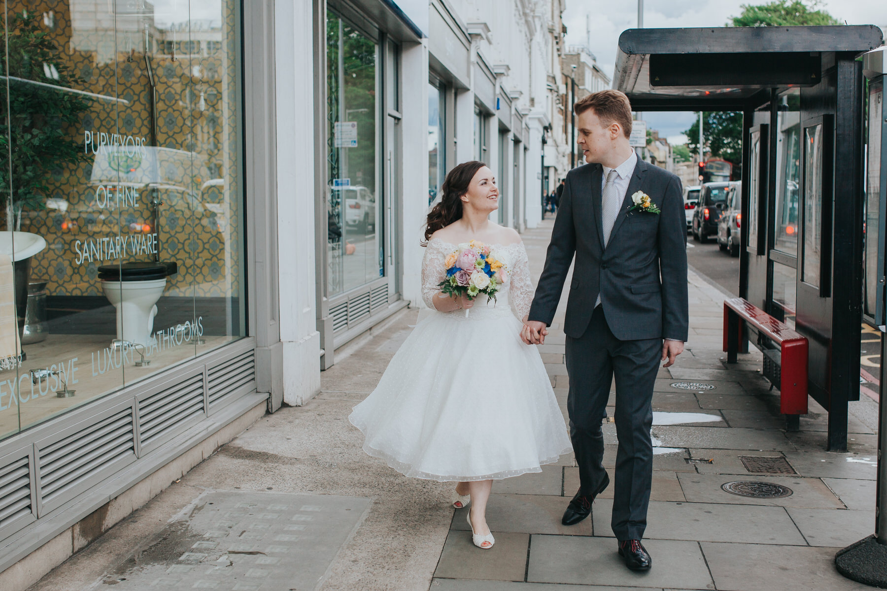 94 groom bride walking down Brompton Rd street reportage.jpg