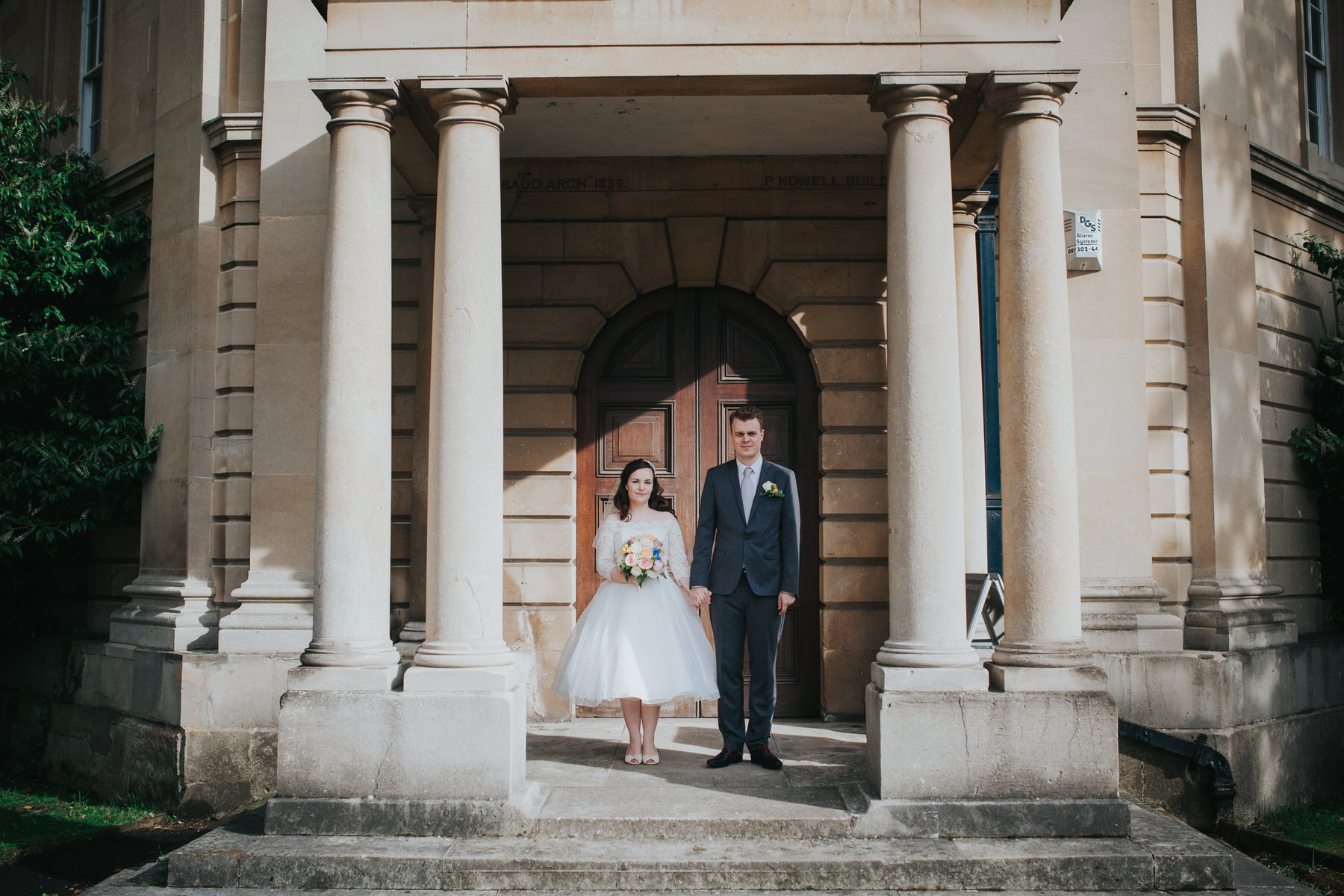 103 groom bride wedding portraits Brompton Cemetery collonades.jpg