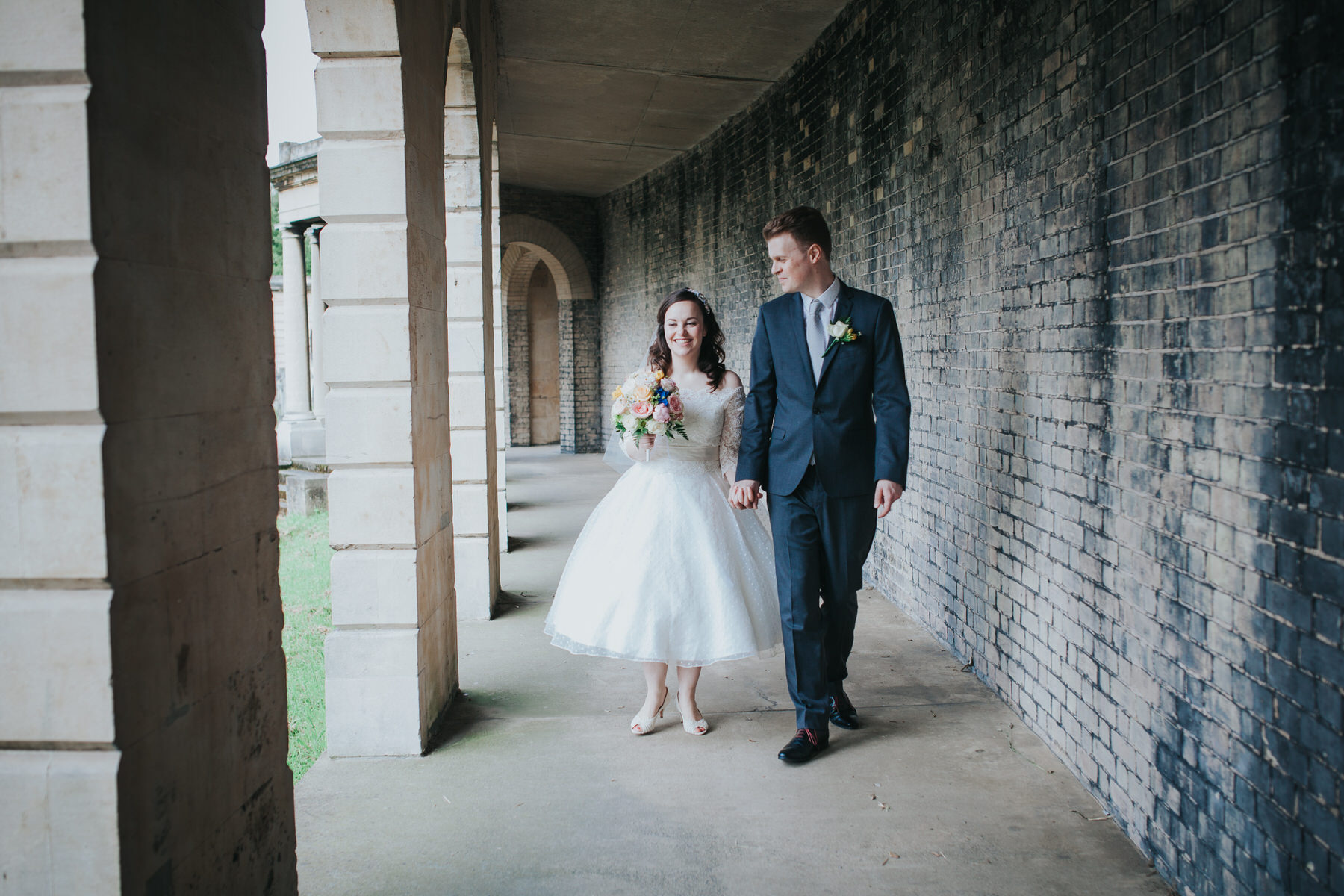 115 groom bride wedding portraits collonade Brompton Cemetery.jpg