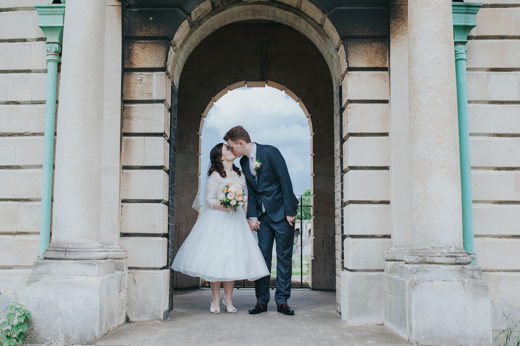 117 groom bride kissing bridal couple portraits Brompton Cemetery.jpg