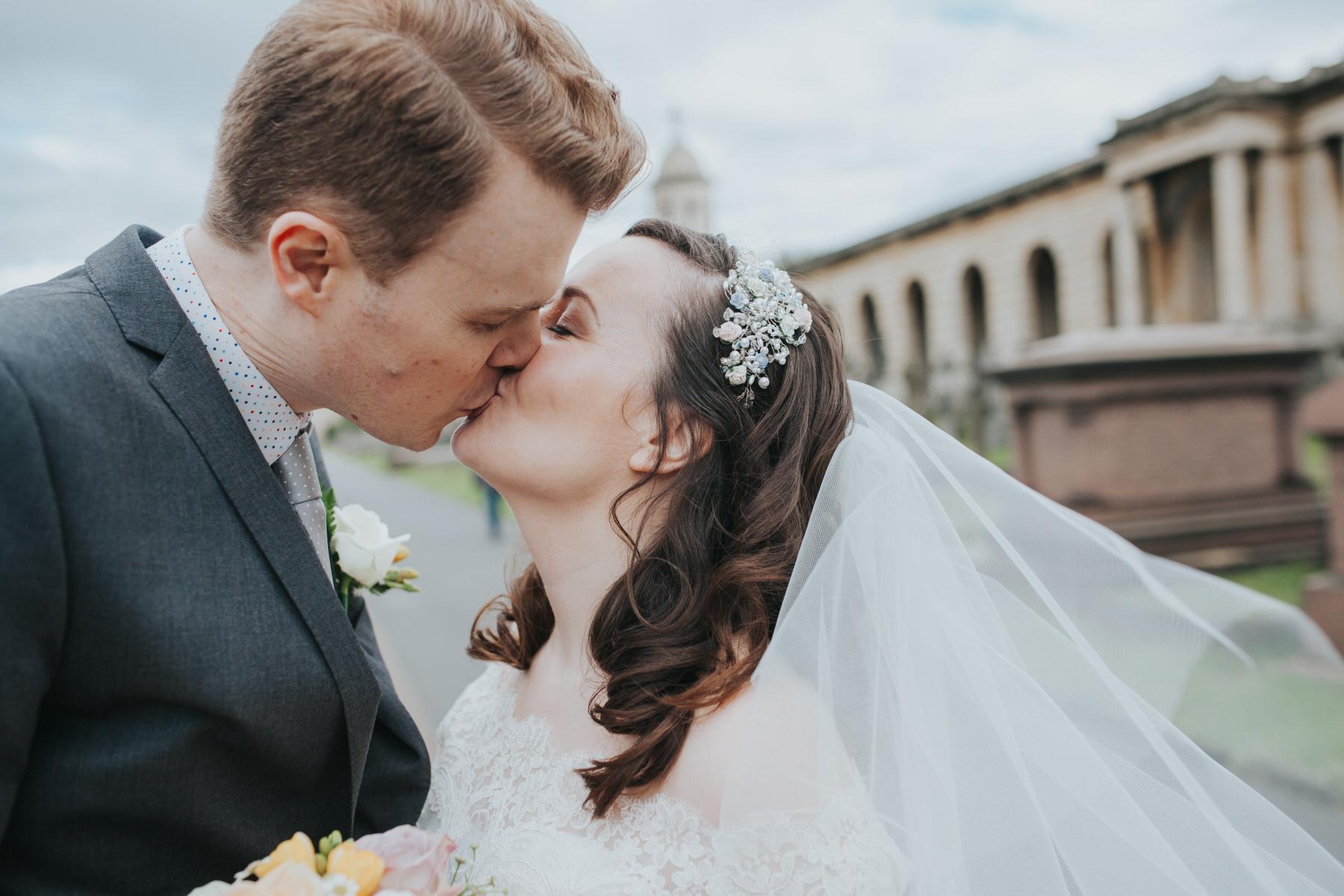 142 groom bride kissing couple portraits windy veil Brompton Cemetery.jpg