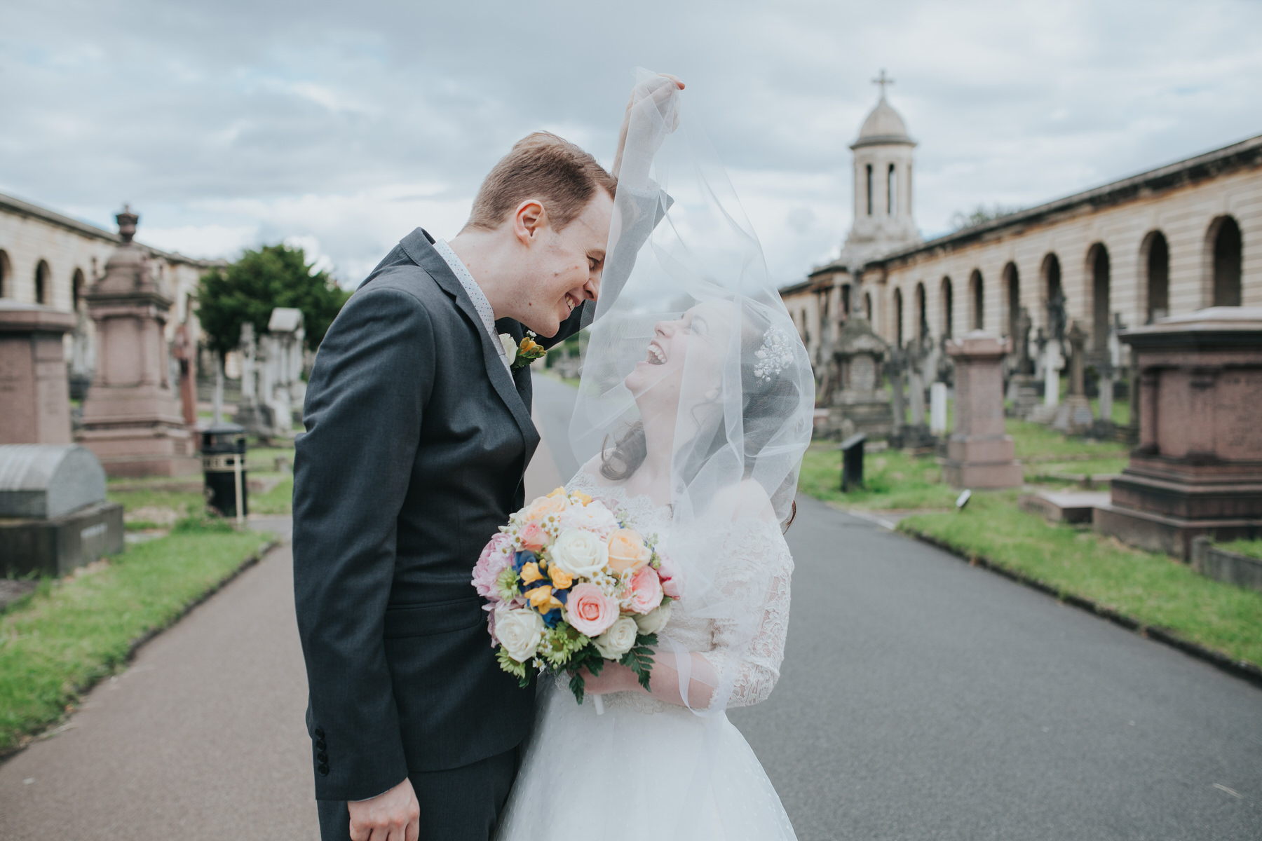 143 groom bride hillarious windy veil Brompton Cemetery.jpg