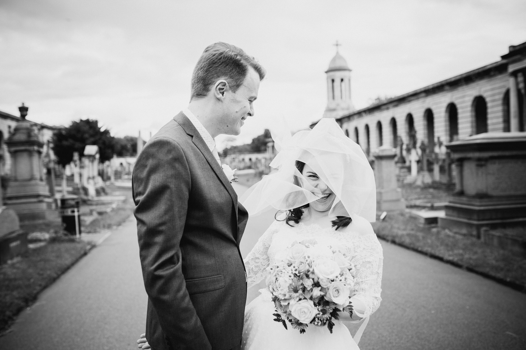 145 groom bride couple portraits windy veil Brompton Cemetery.jpg