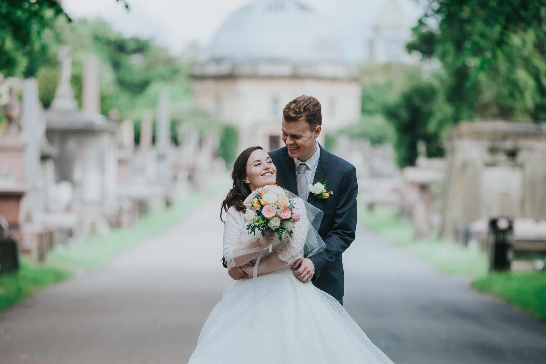 169 happy groom bride dancing Brompton Cemetery wedding.jpg