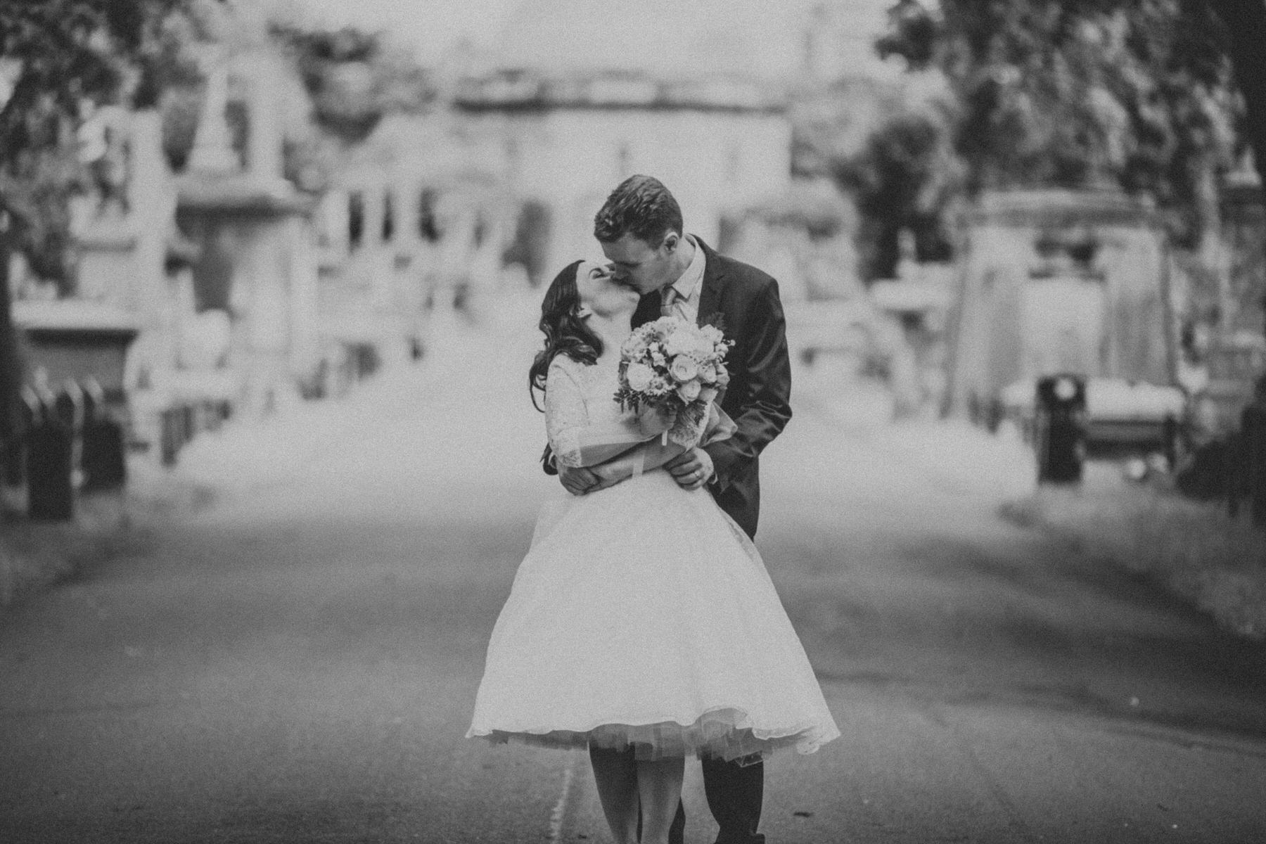 170 BW groom bride kissing wedding portraits Brompton Cemetery_.jpg