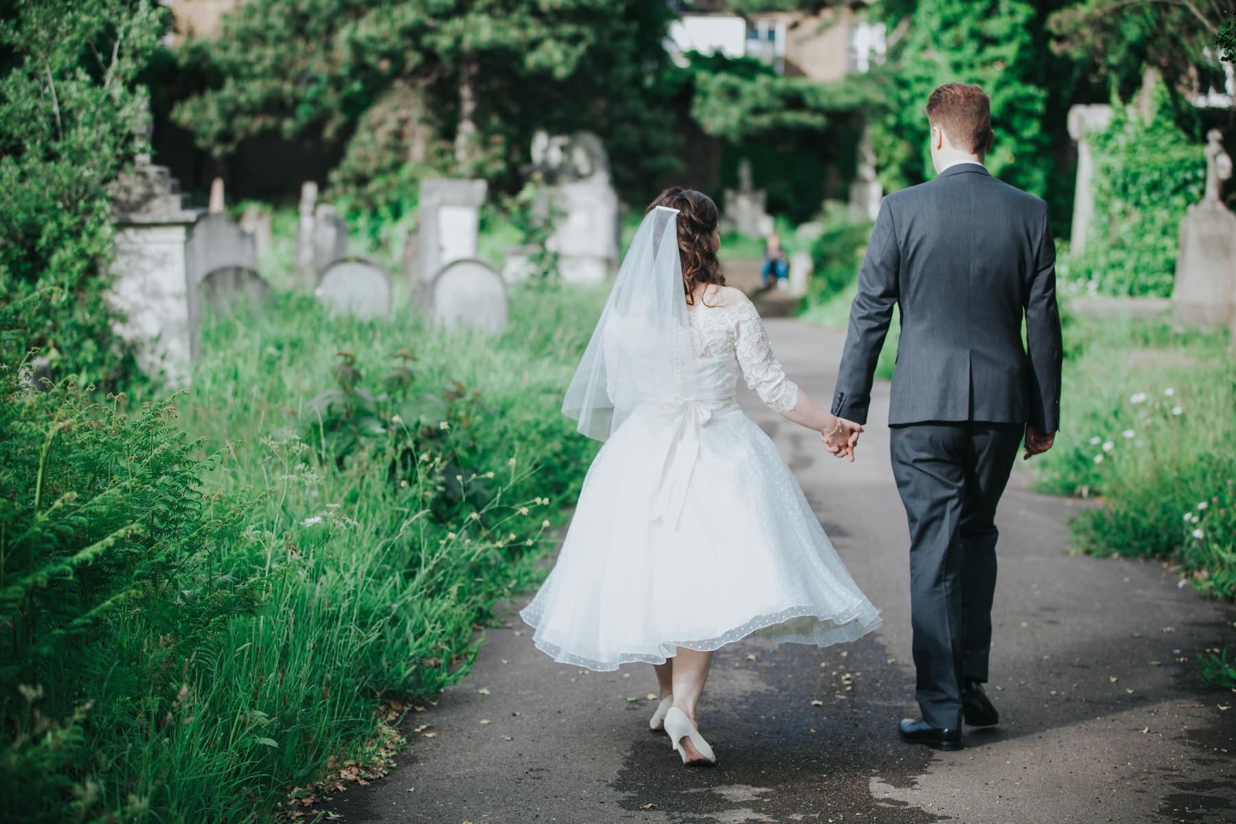 185 groom bride walking Brompton Cemetery.jpg