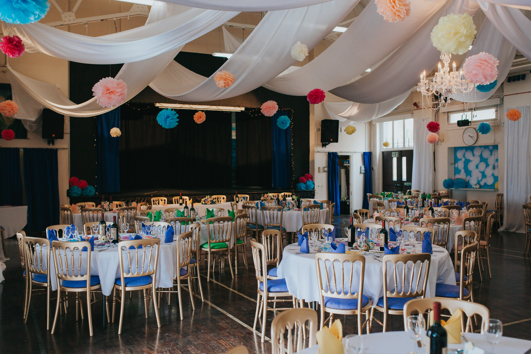 209 school hall colourful pom poms wedding reception decor.jpg